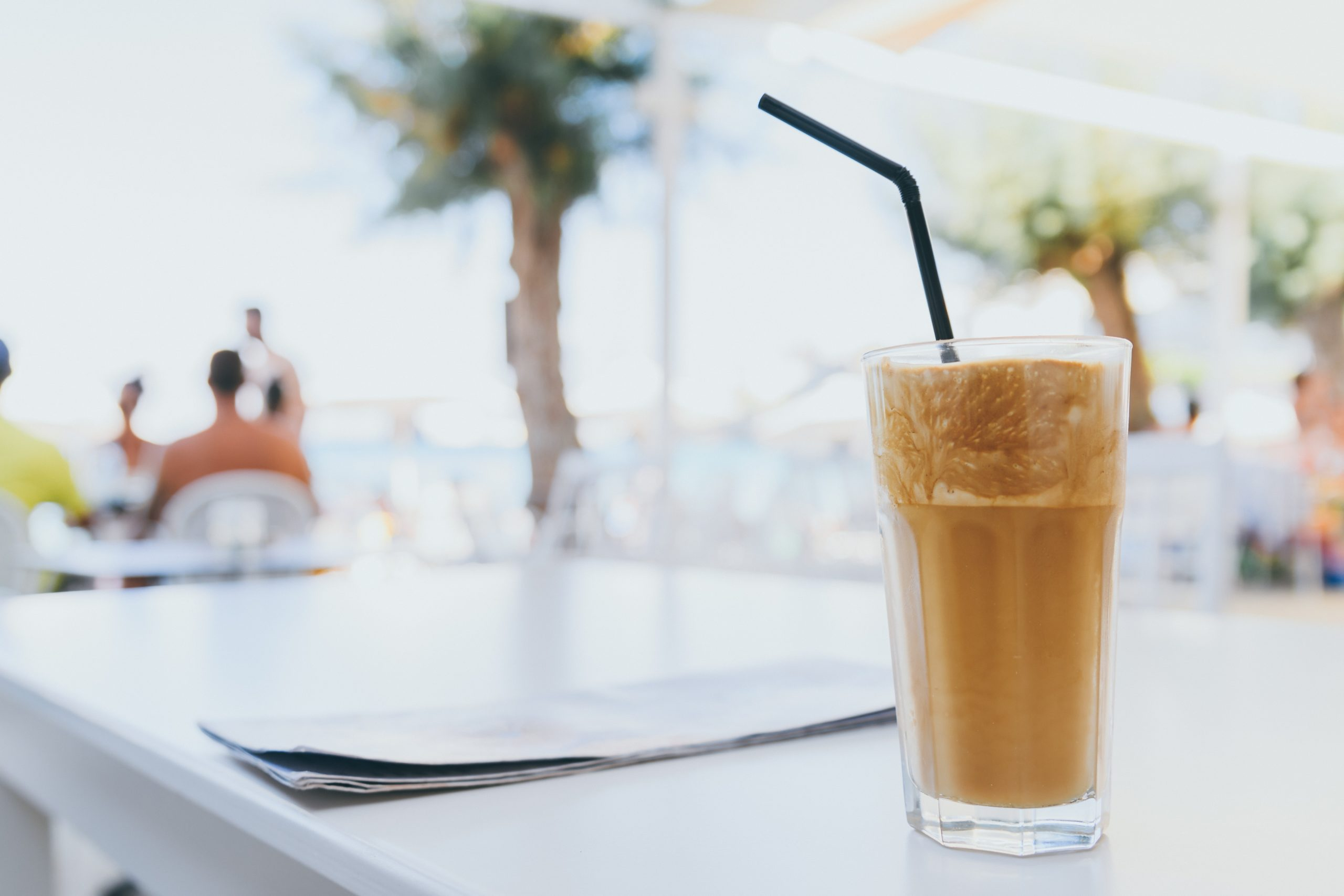 a glass of latte served at a cafe