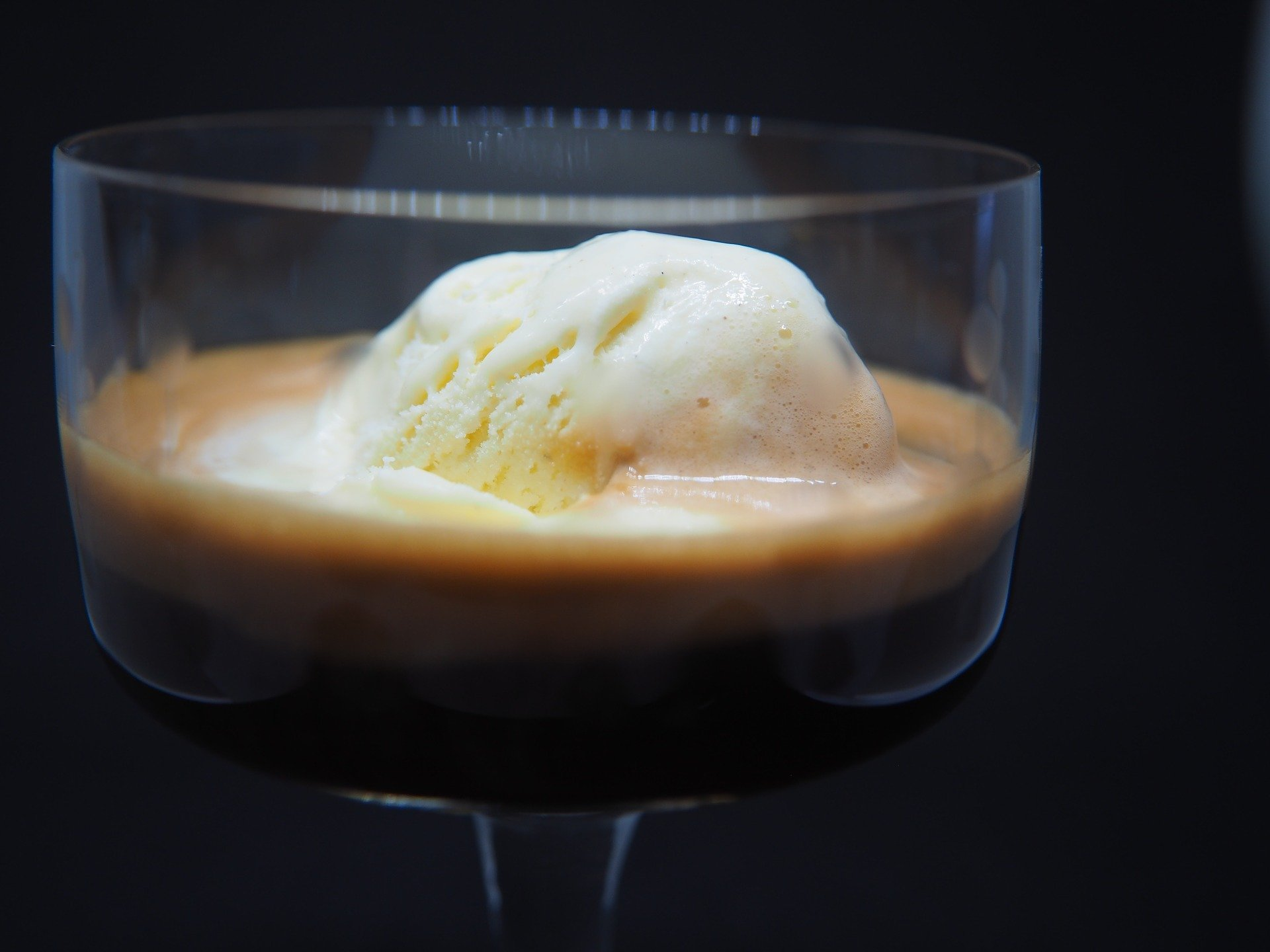 An affogato served in a wine glass