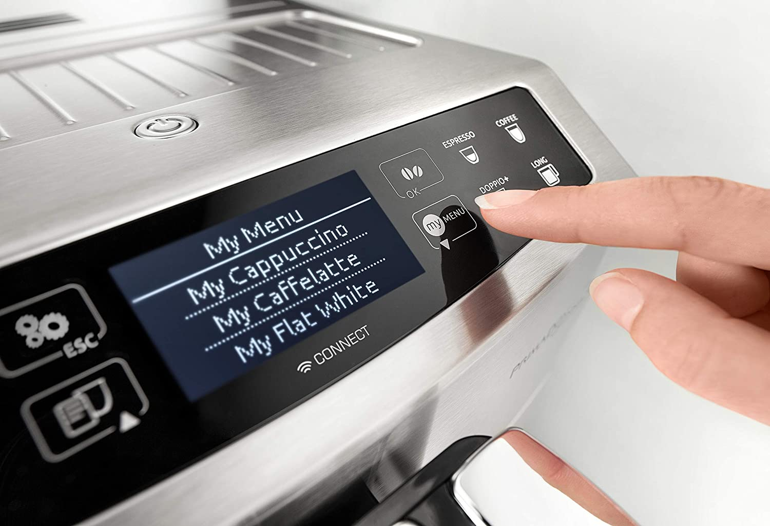 finger pressing a button on a coffee machine