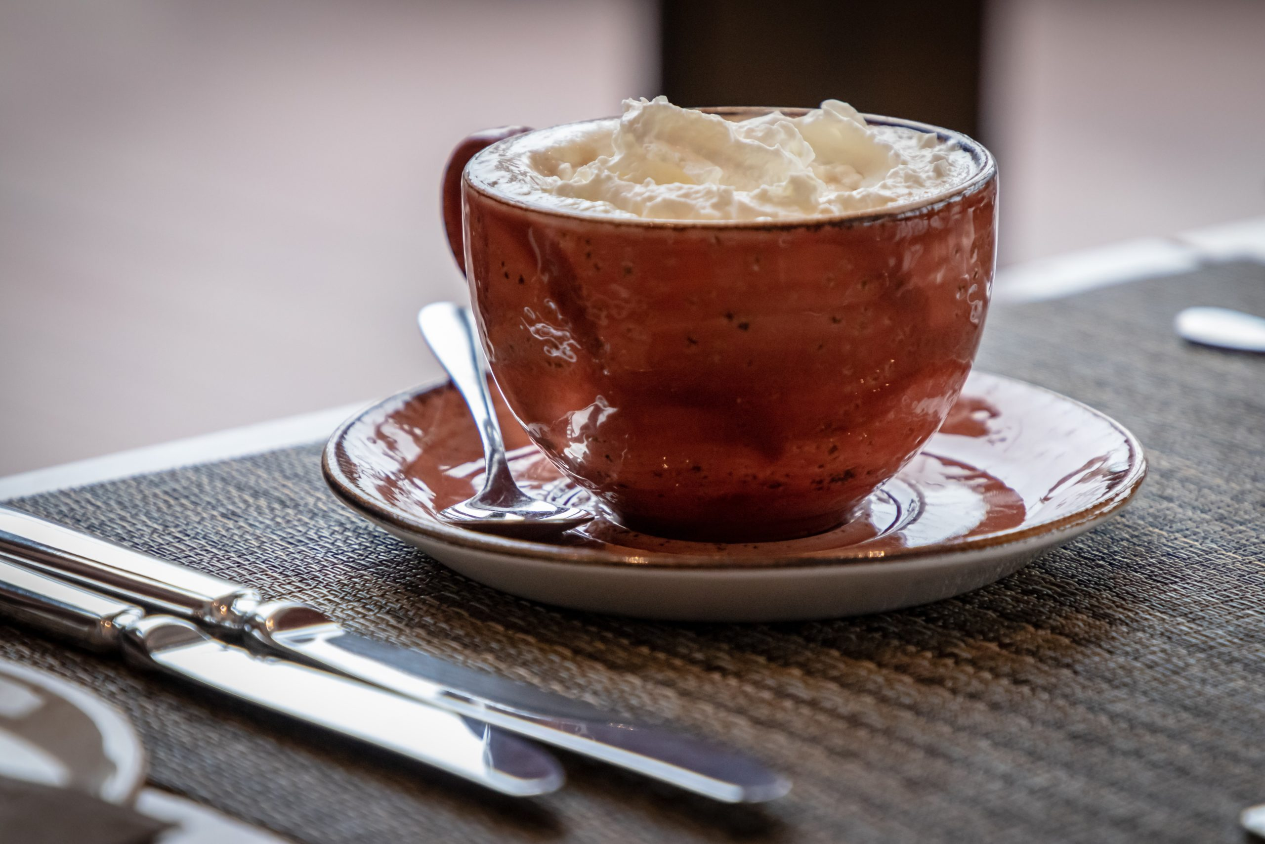 a cup of vienna topped with whipped cream