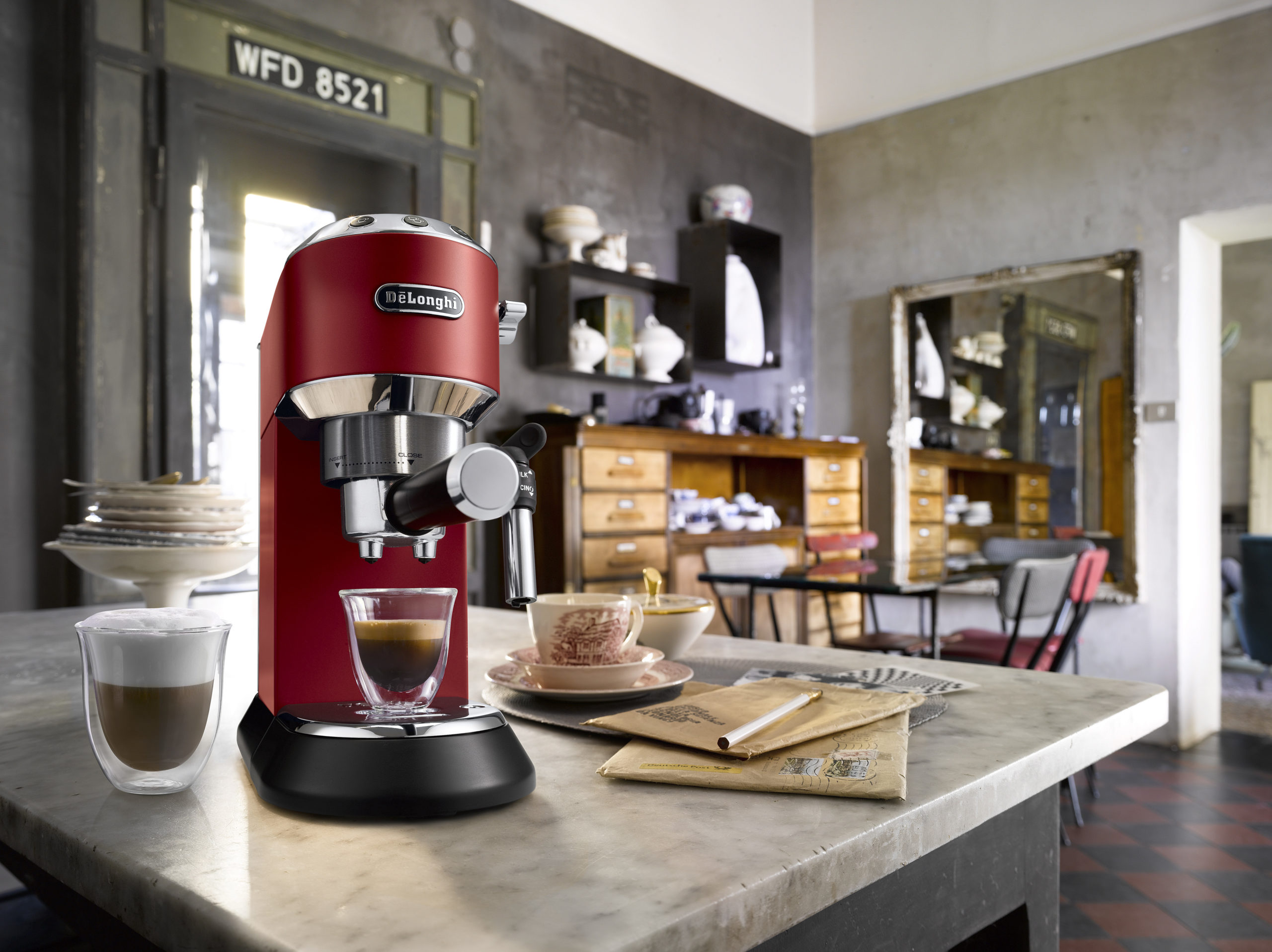 red coffee machine on kitchen table