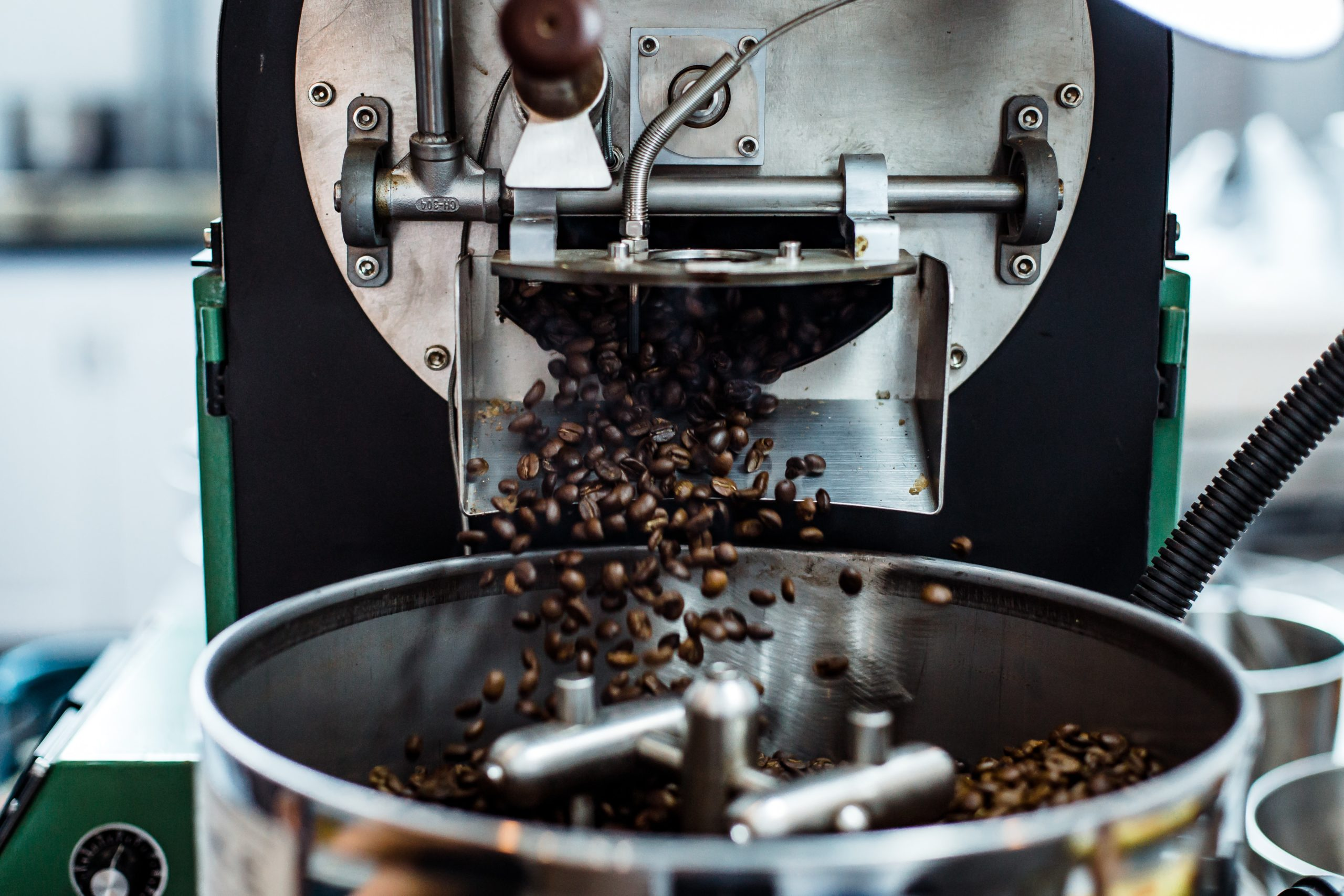 coffee beans coming out from a bean roasting machine