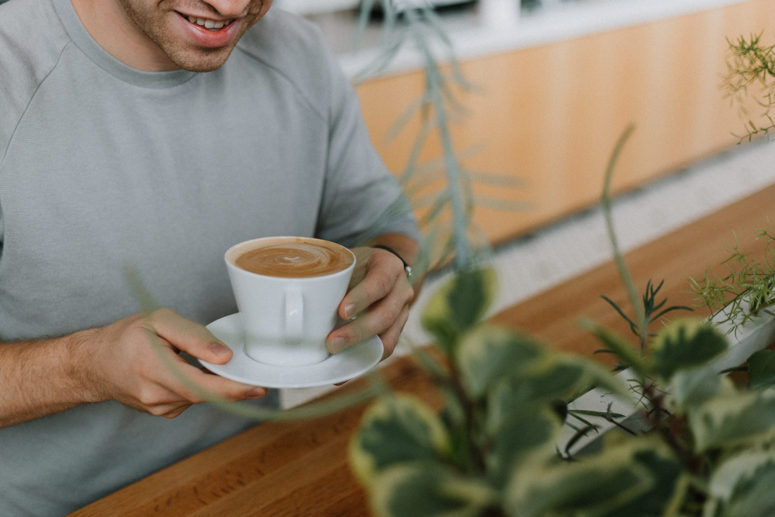 A man holding a cup of coffee