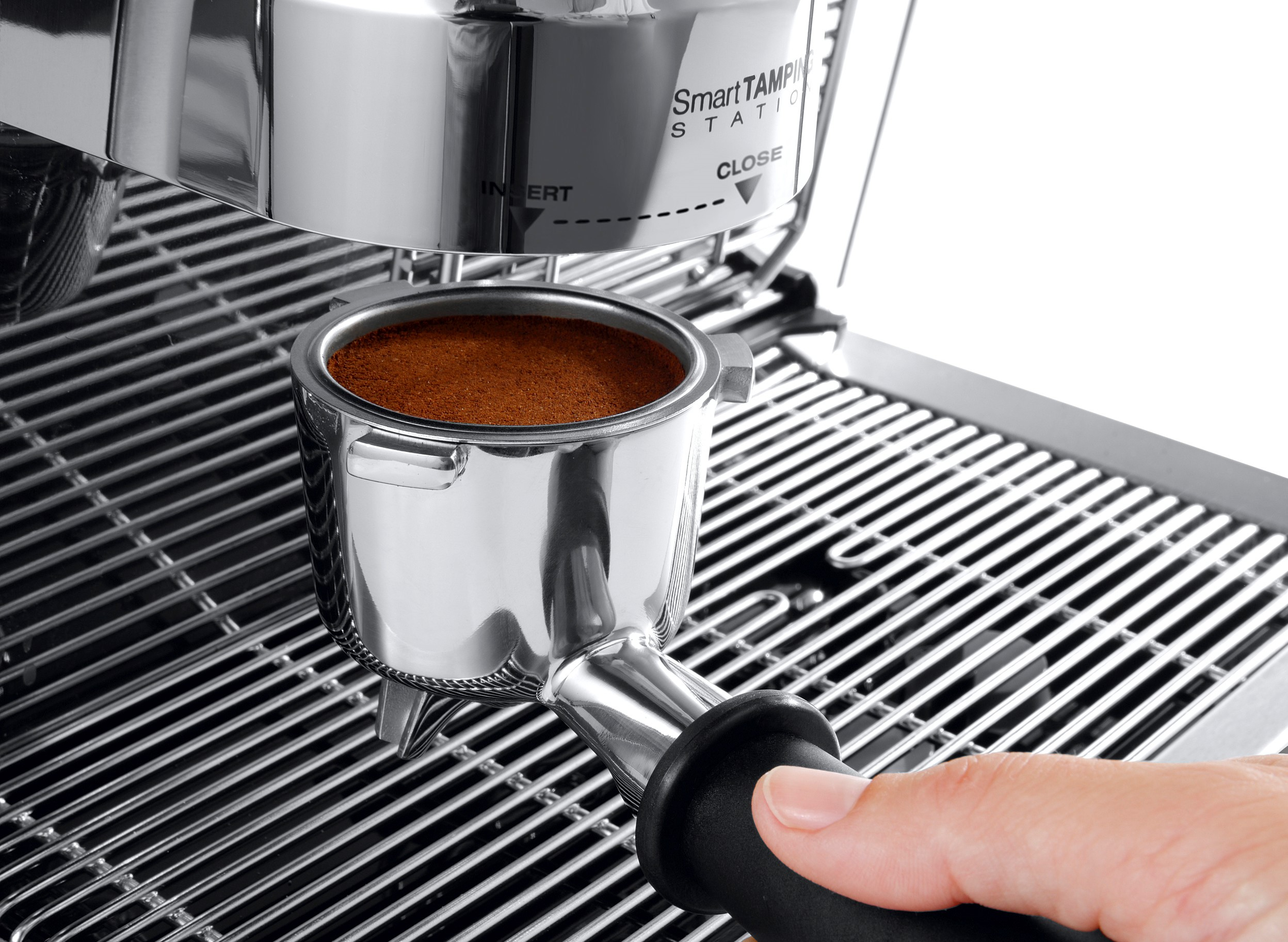 tamping coffee grounds in a portafilter