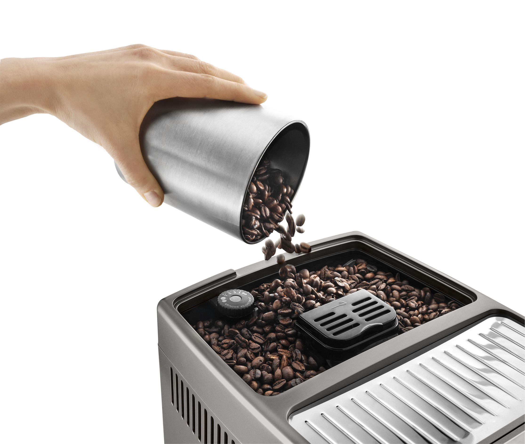 pouring coffee beans into a bean hopper of a coffee machine