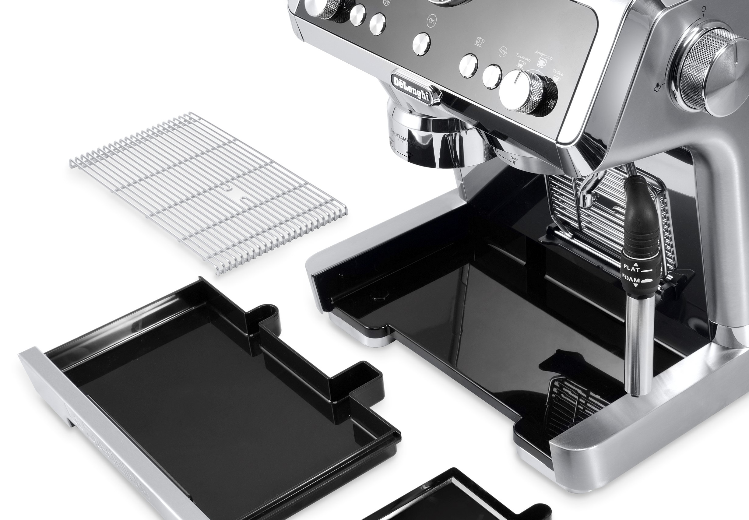parts of a coffee machine laid out on a table