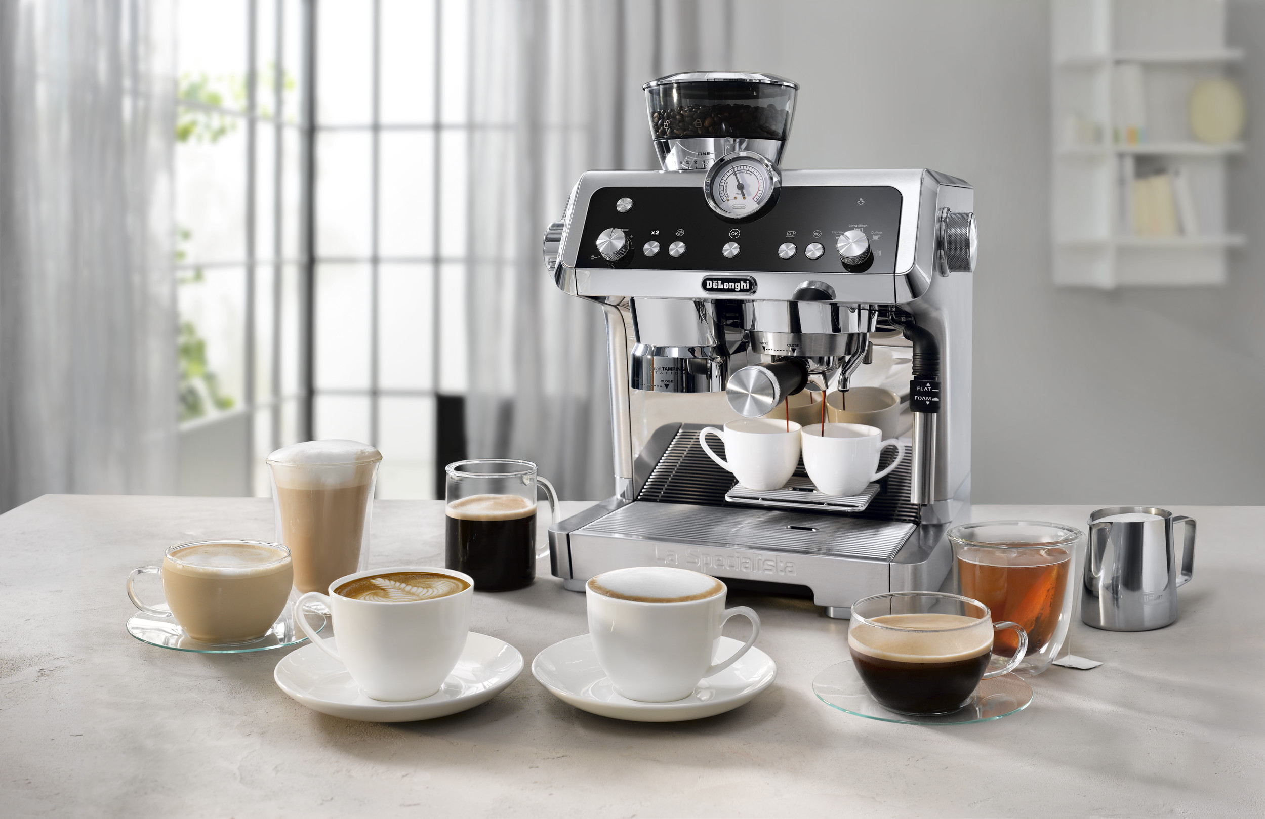 multiple coffee beverages placed in front of a coffee machine