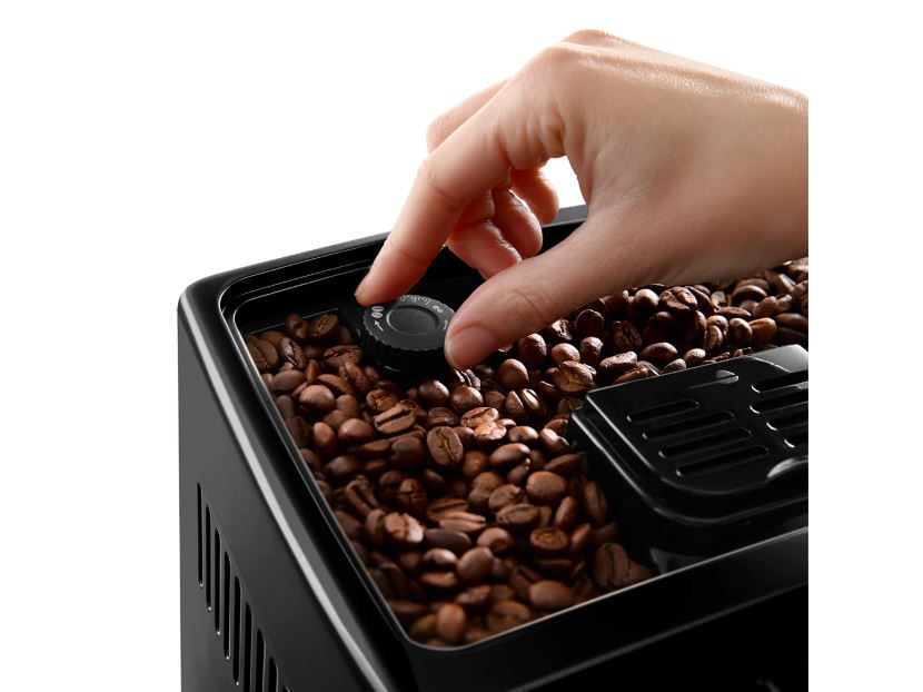 adjusting the coffee grind size knob of a coffee machine