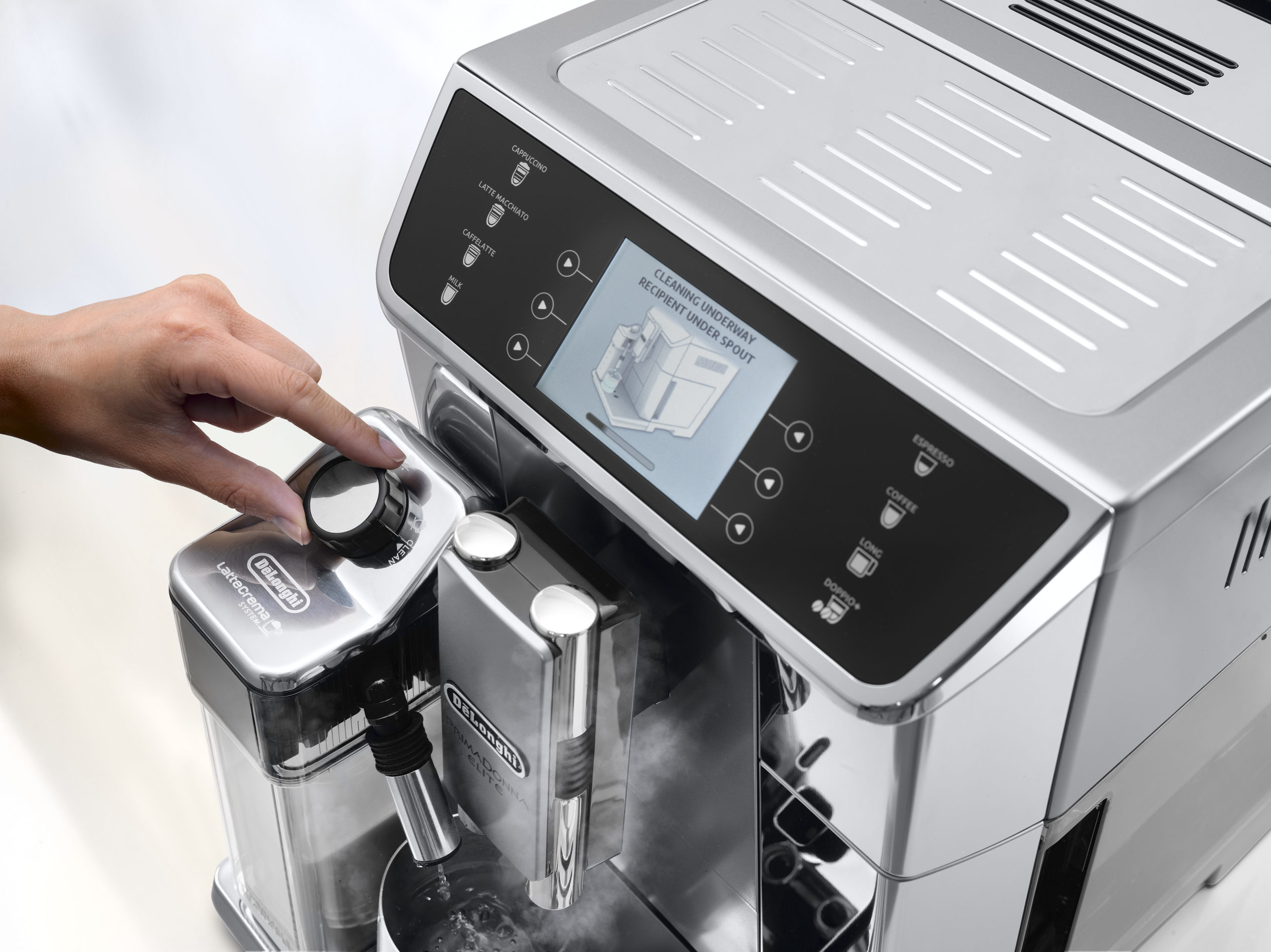 a person turning a knob of a coffee machine