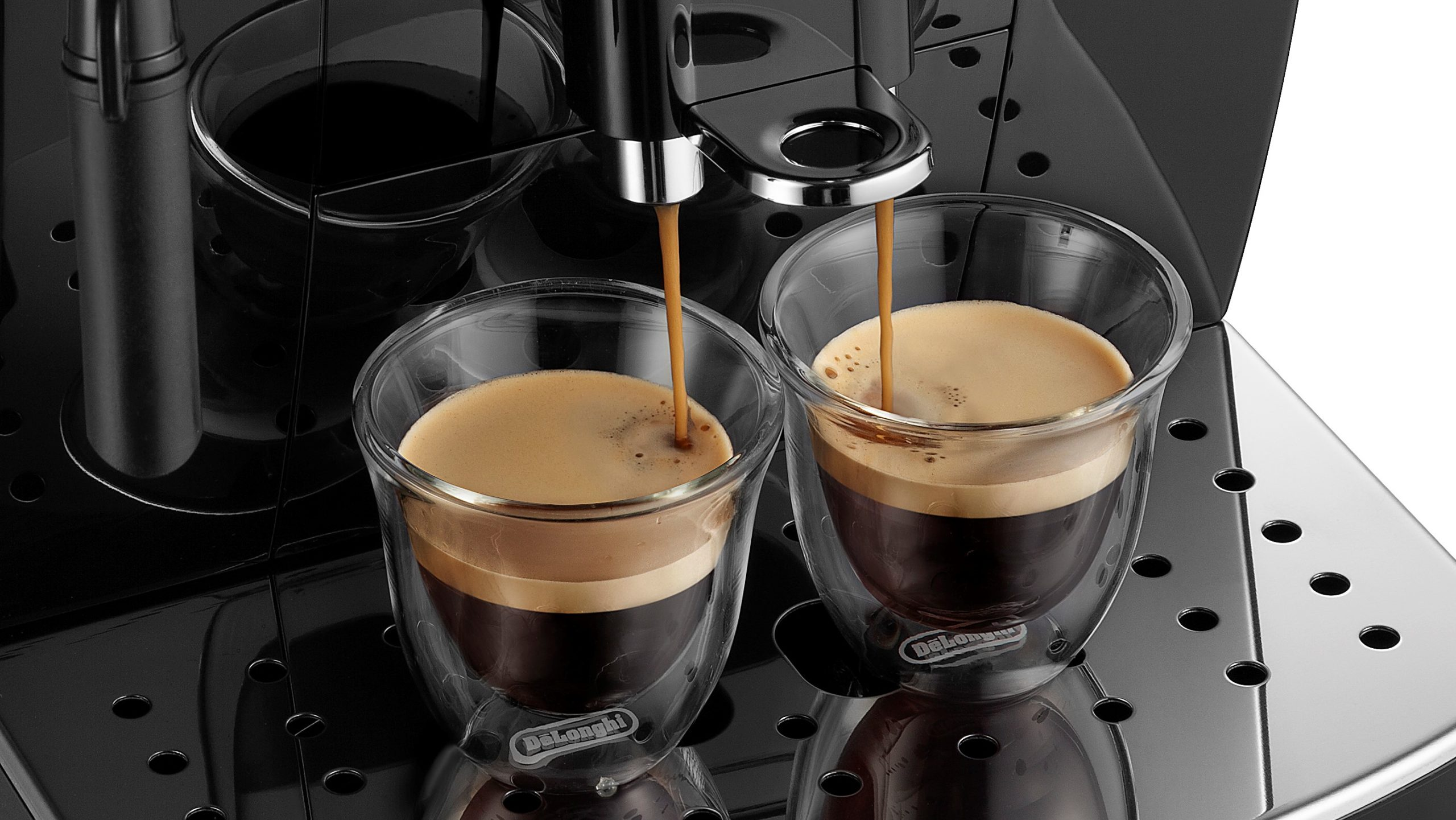 espresso being extracted into two espresso shot cups