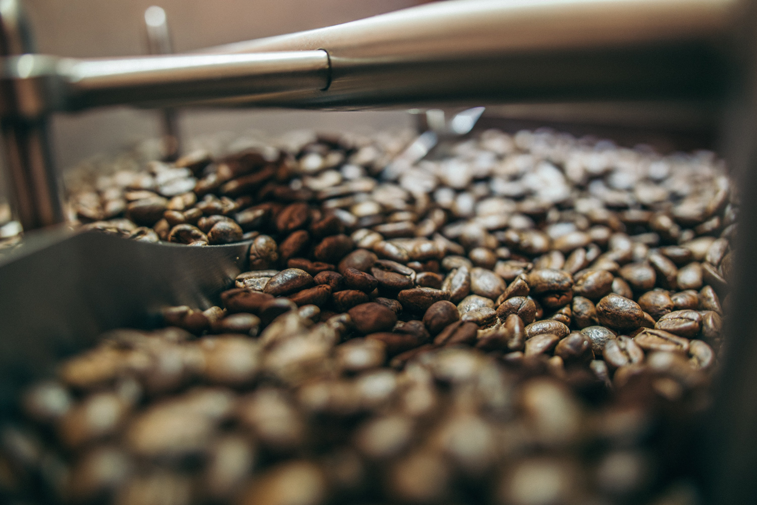 coffee beans being roasted in a machine