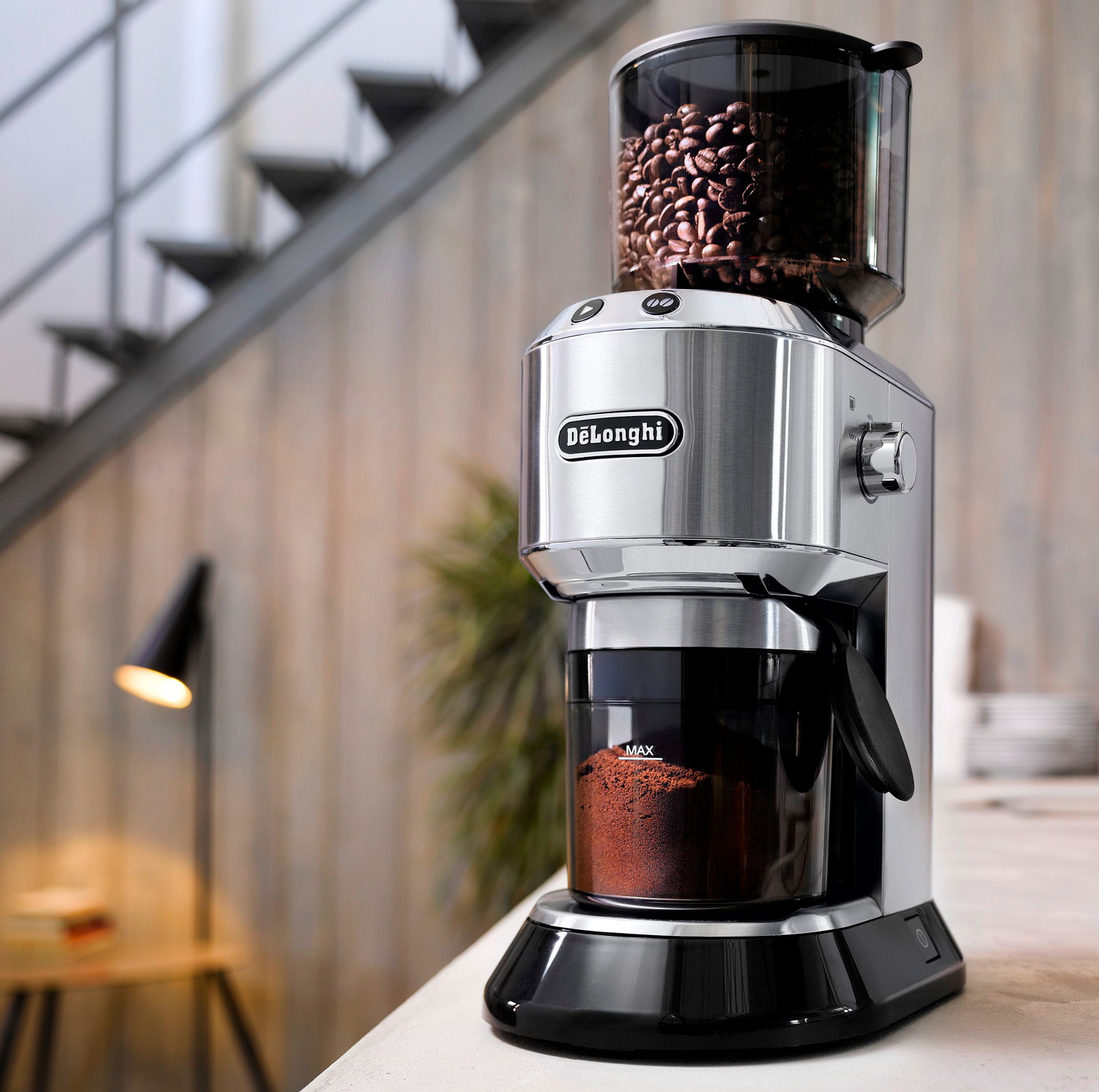 a coffee grinding machine placed on a table