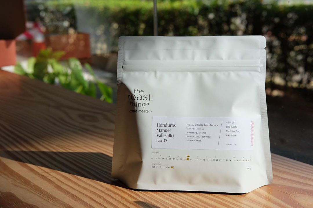 a white-coloured bag of coffee beans from The Roast Things