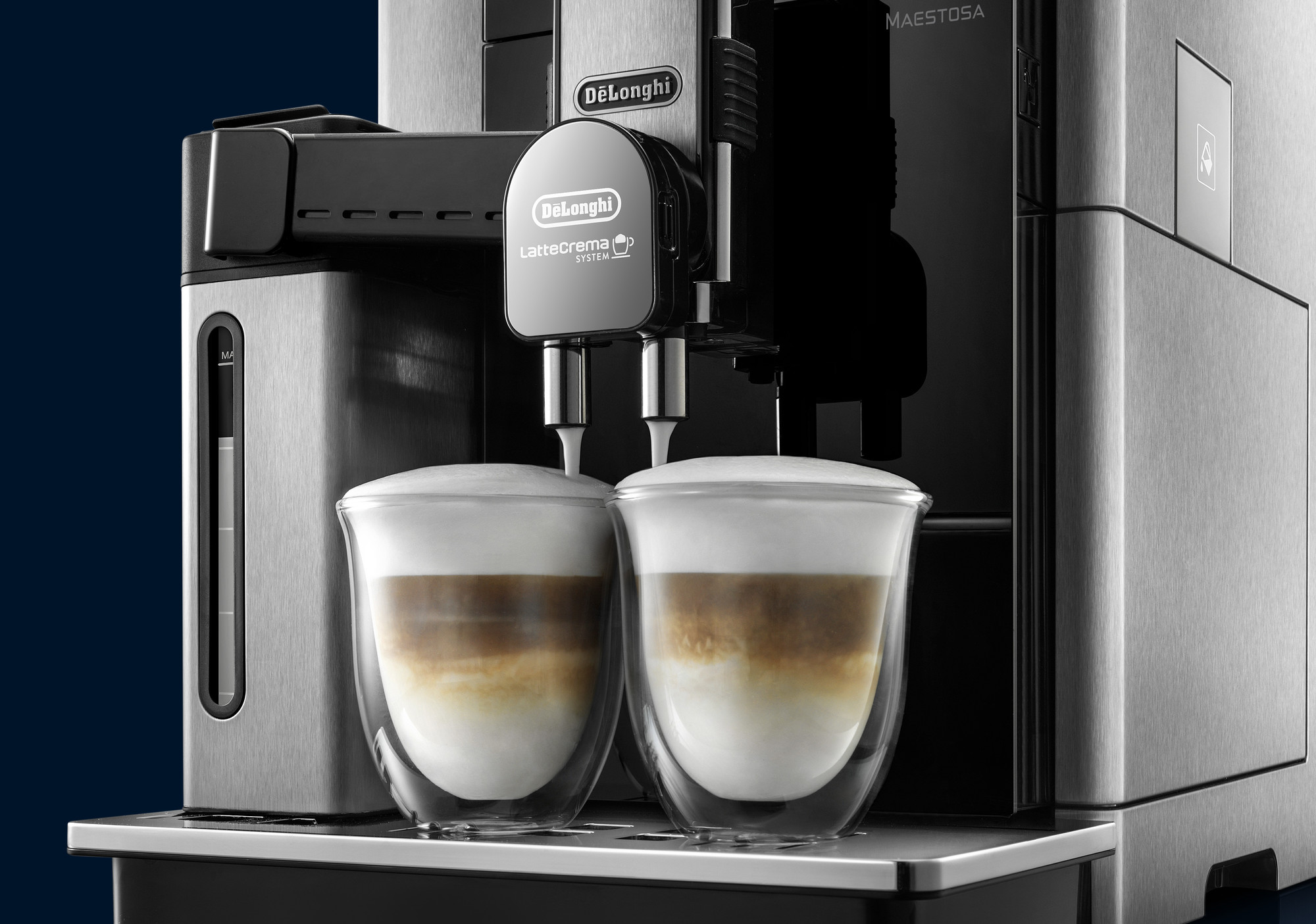 De'Longhi Maestosa Coffee Machine extracting espresso into two cups