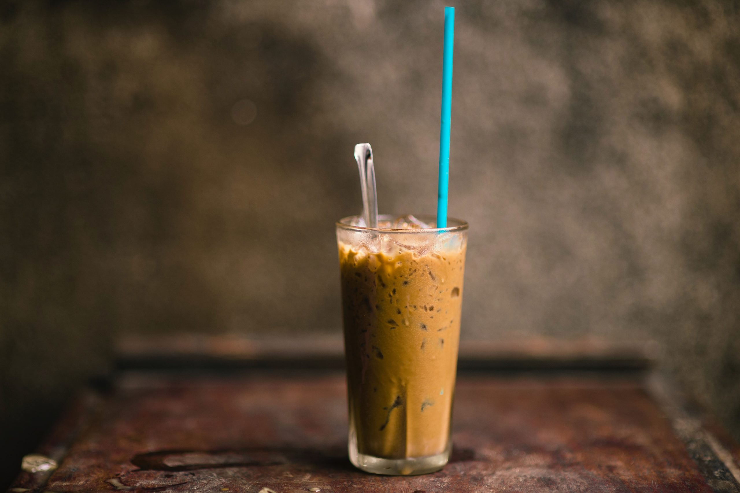 a tall glass of iced vietnamese coffee