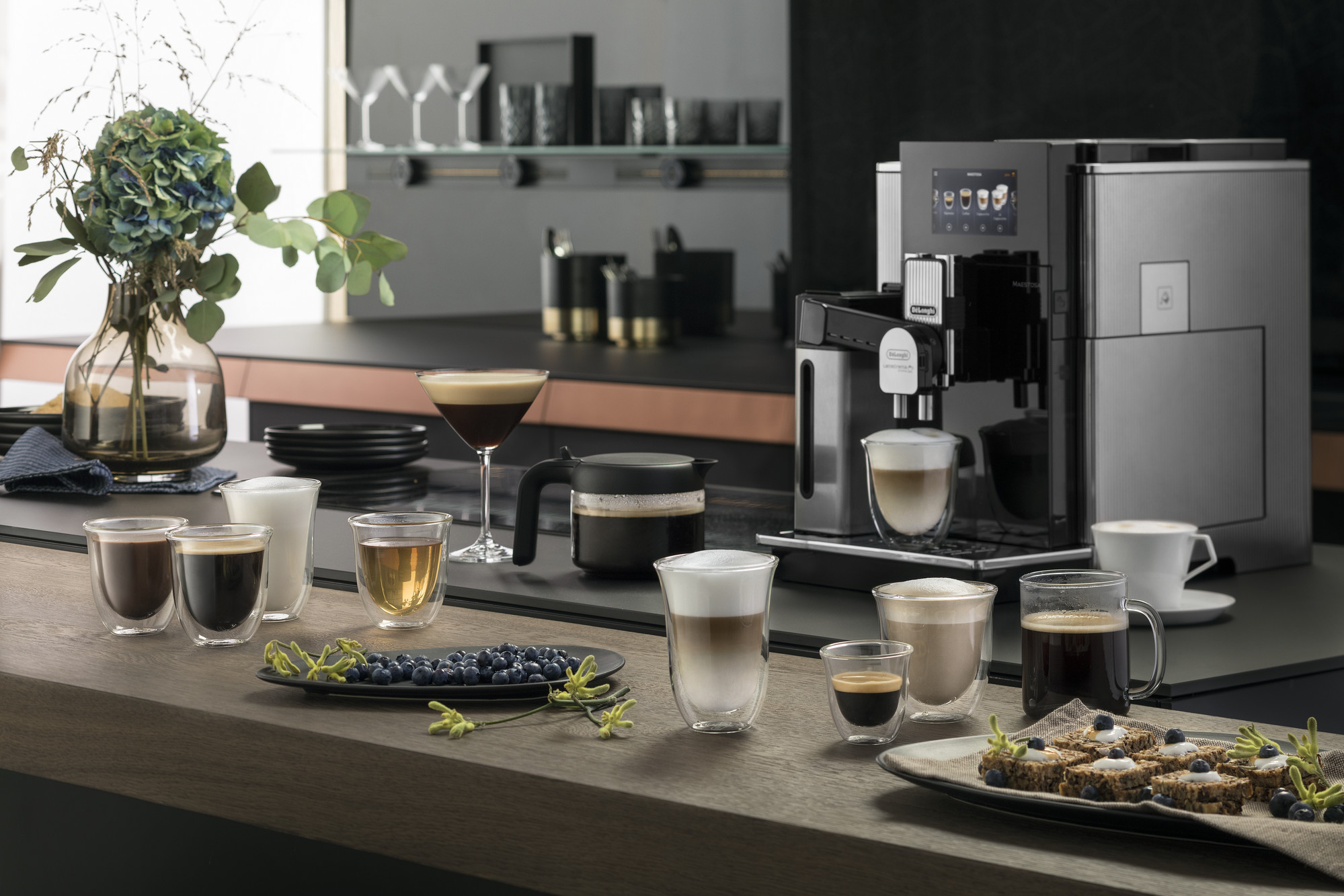 De'Longhi Maestosa Coffee Machine and a variety of drinks