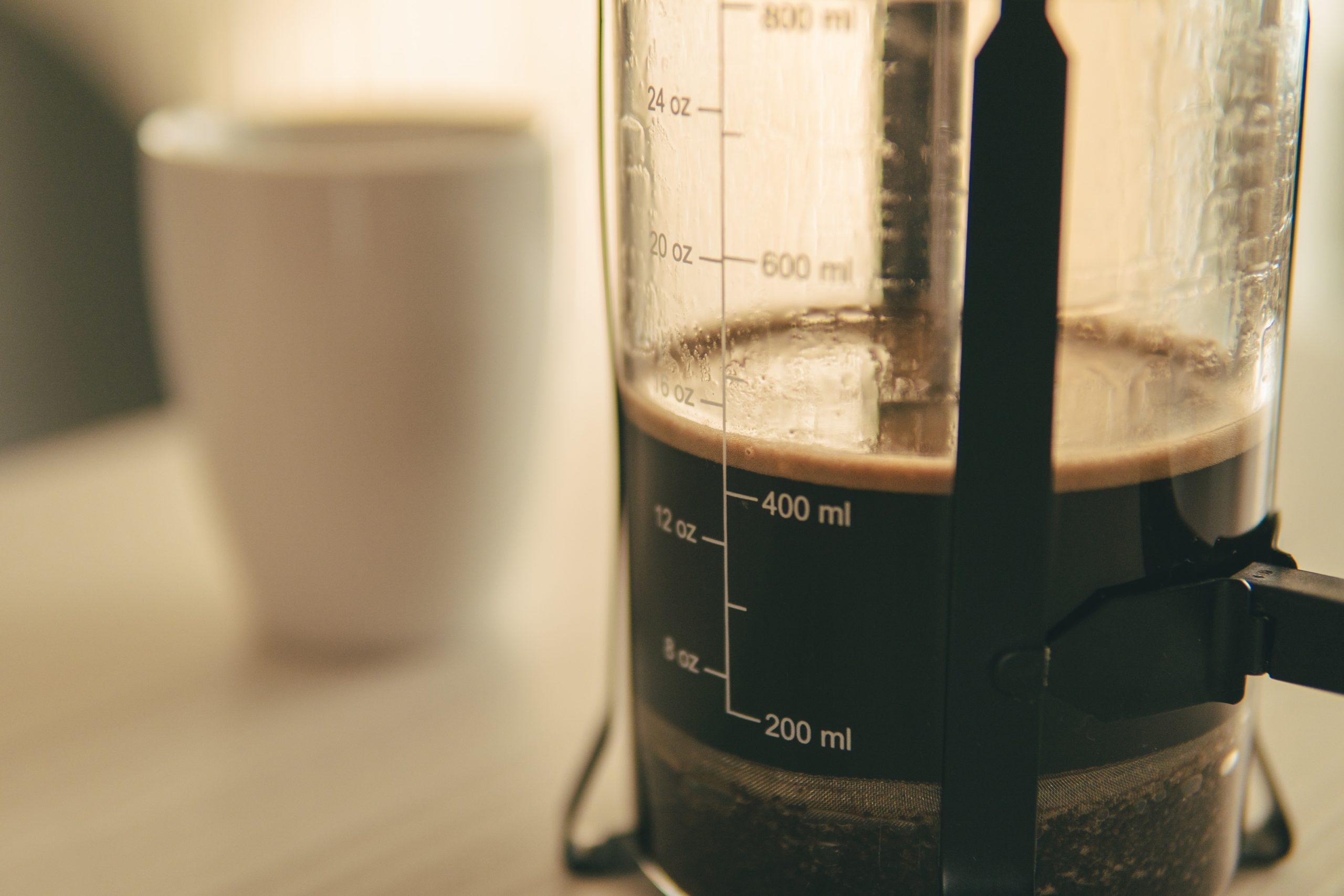 a close up shot of coffee in a french press