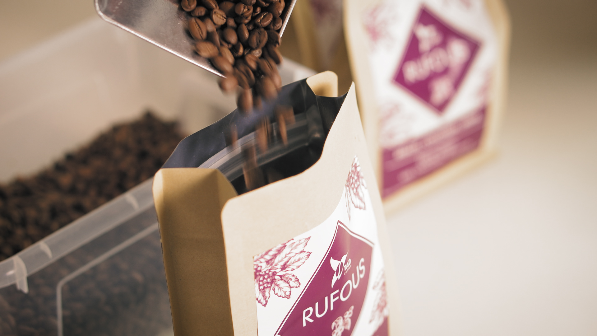coffee beans being poured into a coffee bag