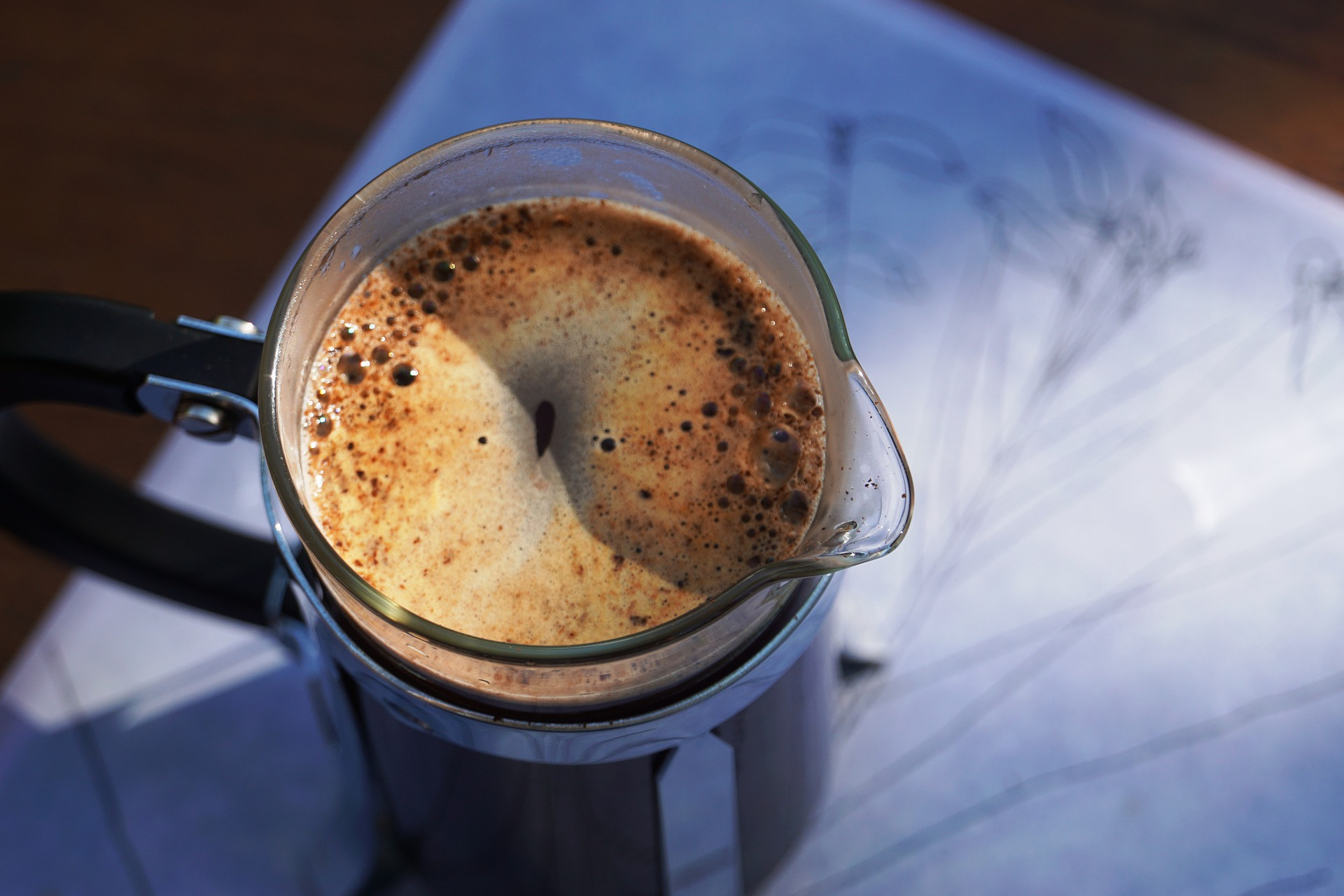 a top view of a french press filled with coffee