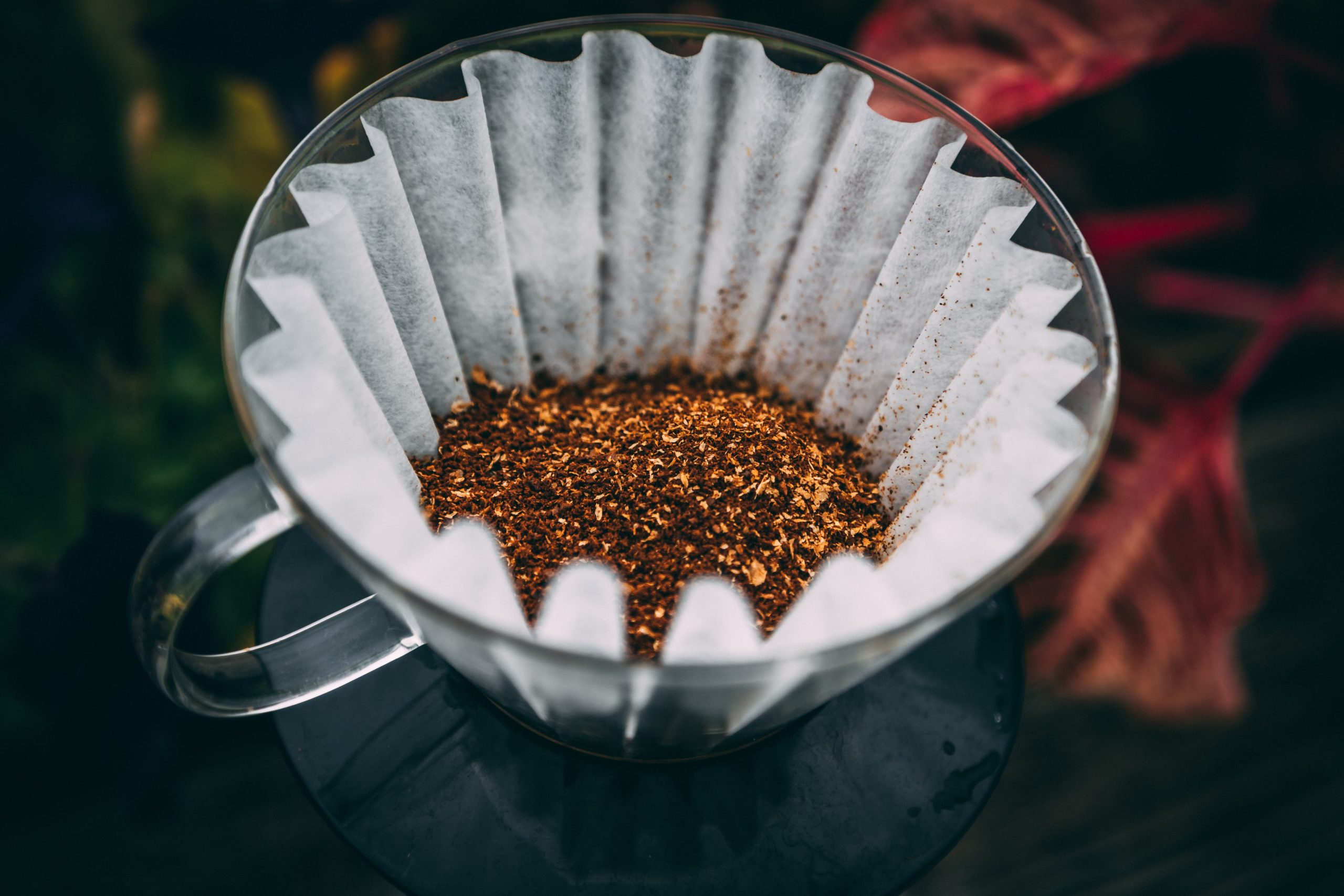 coarse ground coffee in a coffee filter drip cup