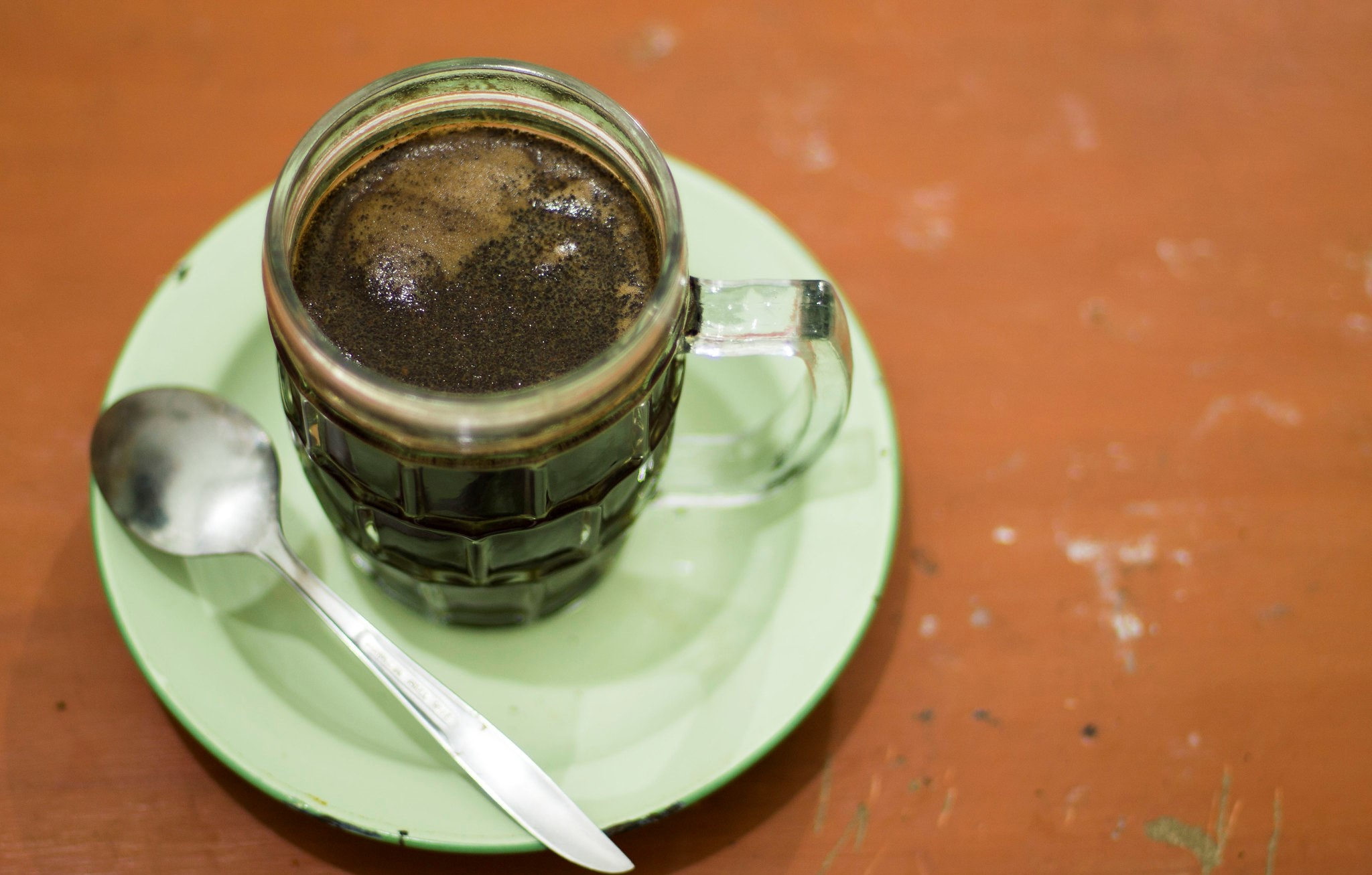 a glass mug filled with coffee