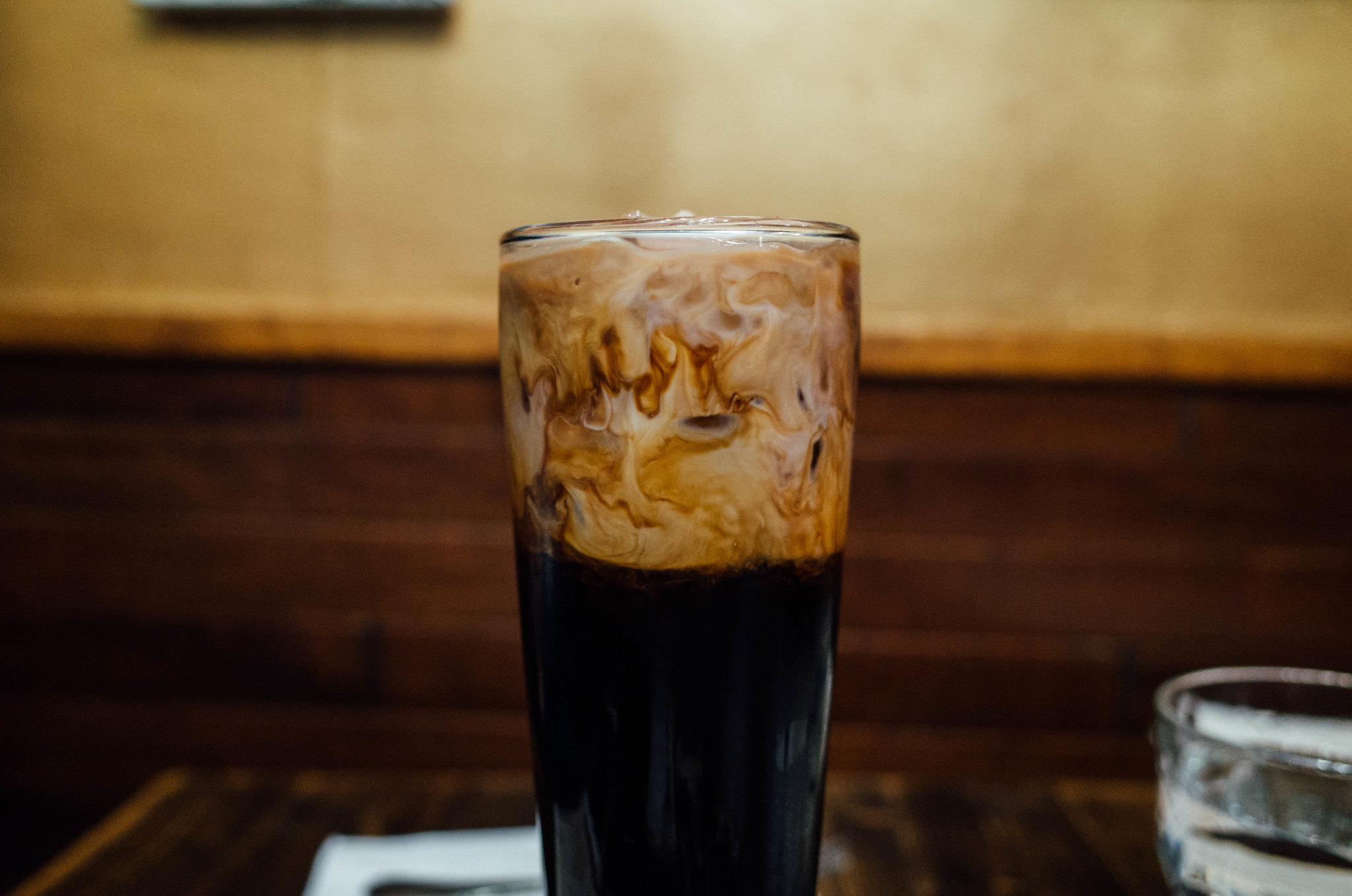 a glass of iced coffee and milk