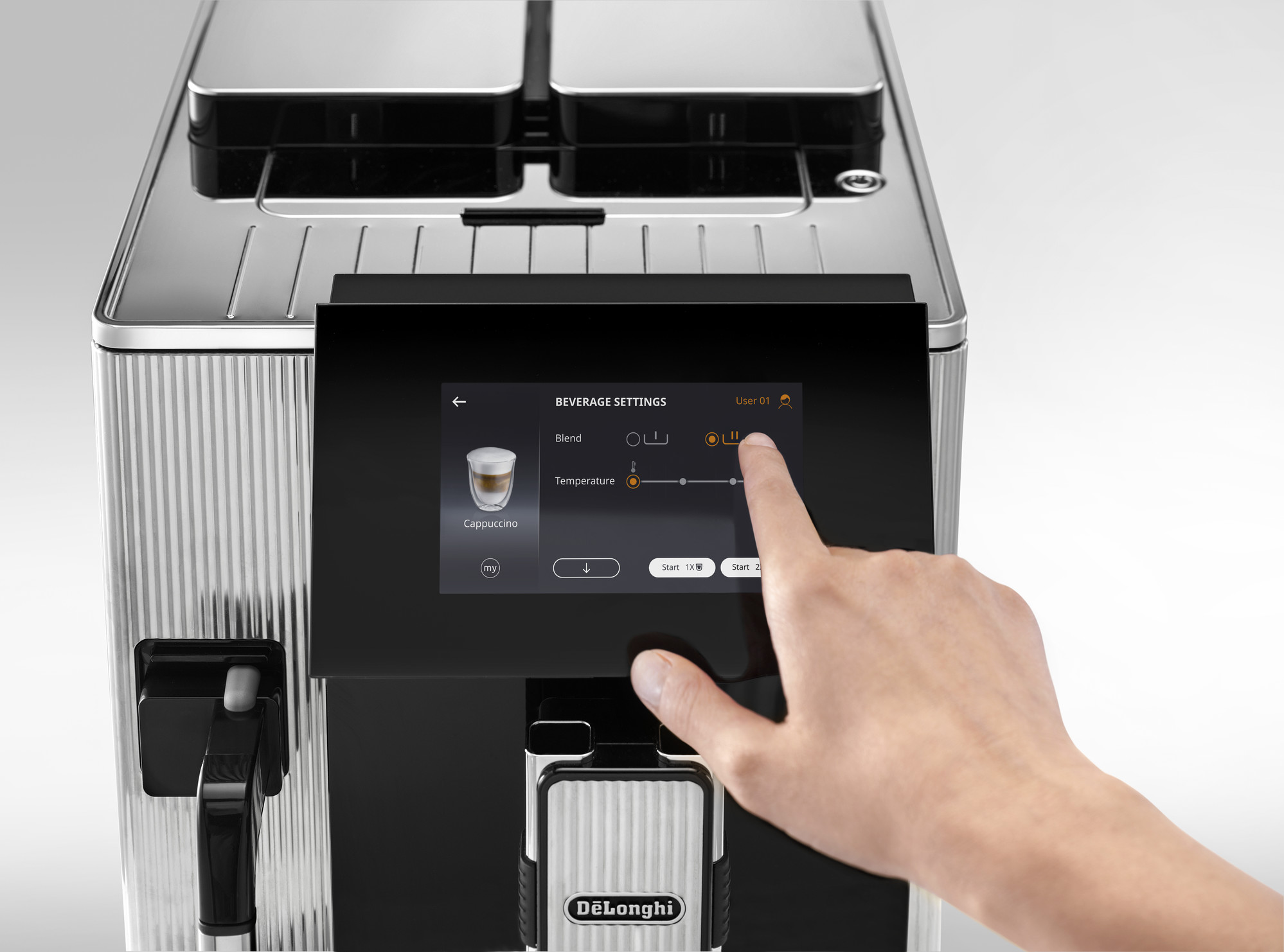A person pressing a button on a coffee machine's display screen
