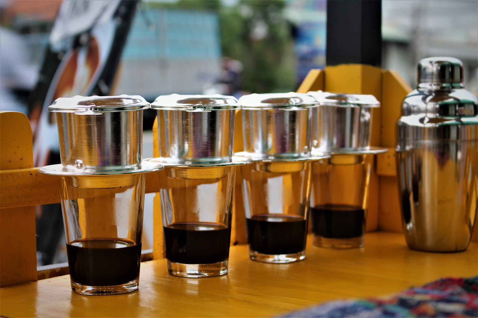 multiple glasses of Vietnamese Phin Filter Coffee placed in a row