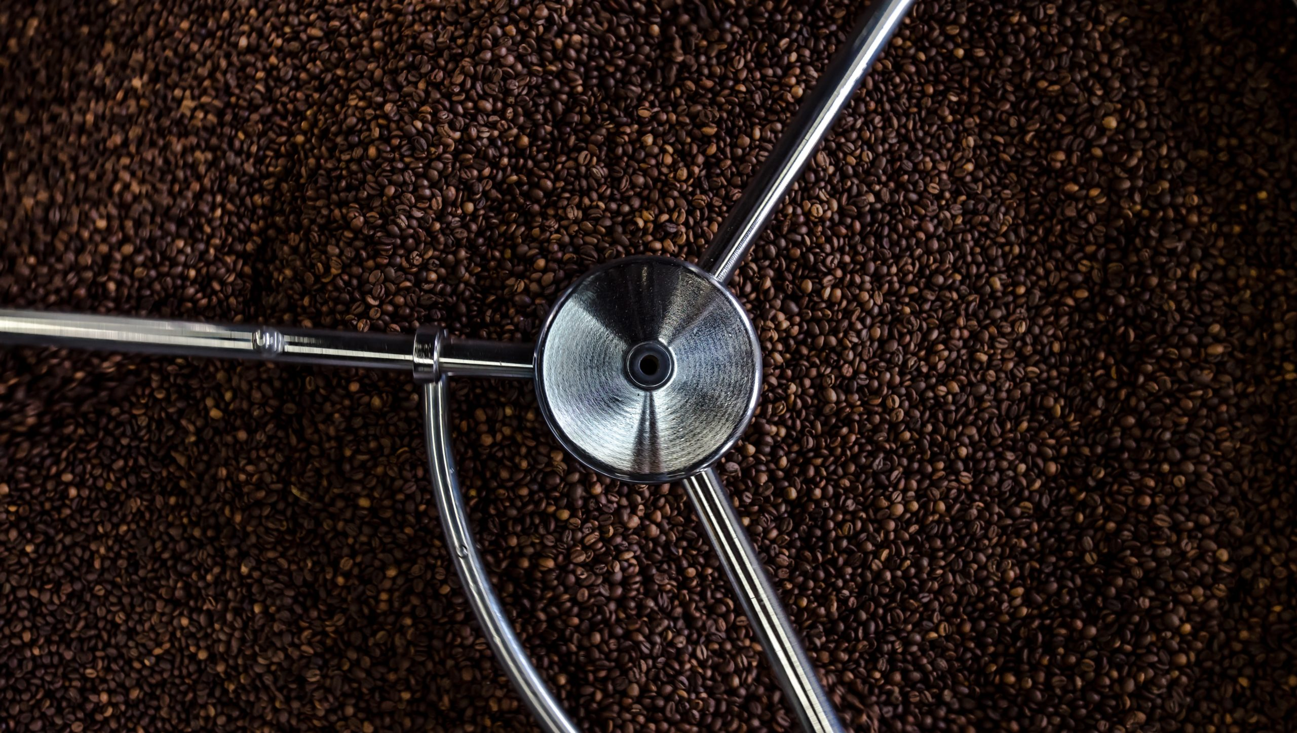 an aerial view of coffee beans being roasted