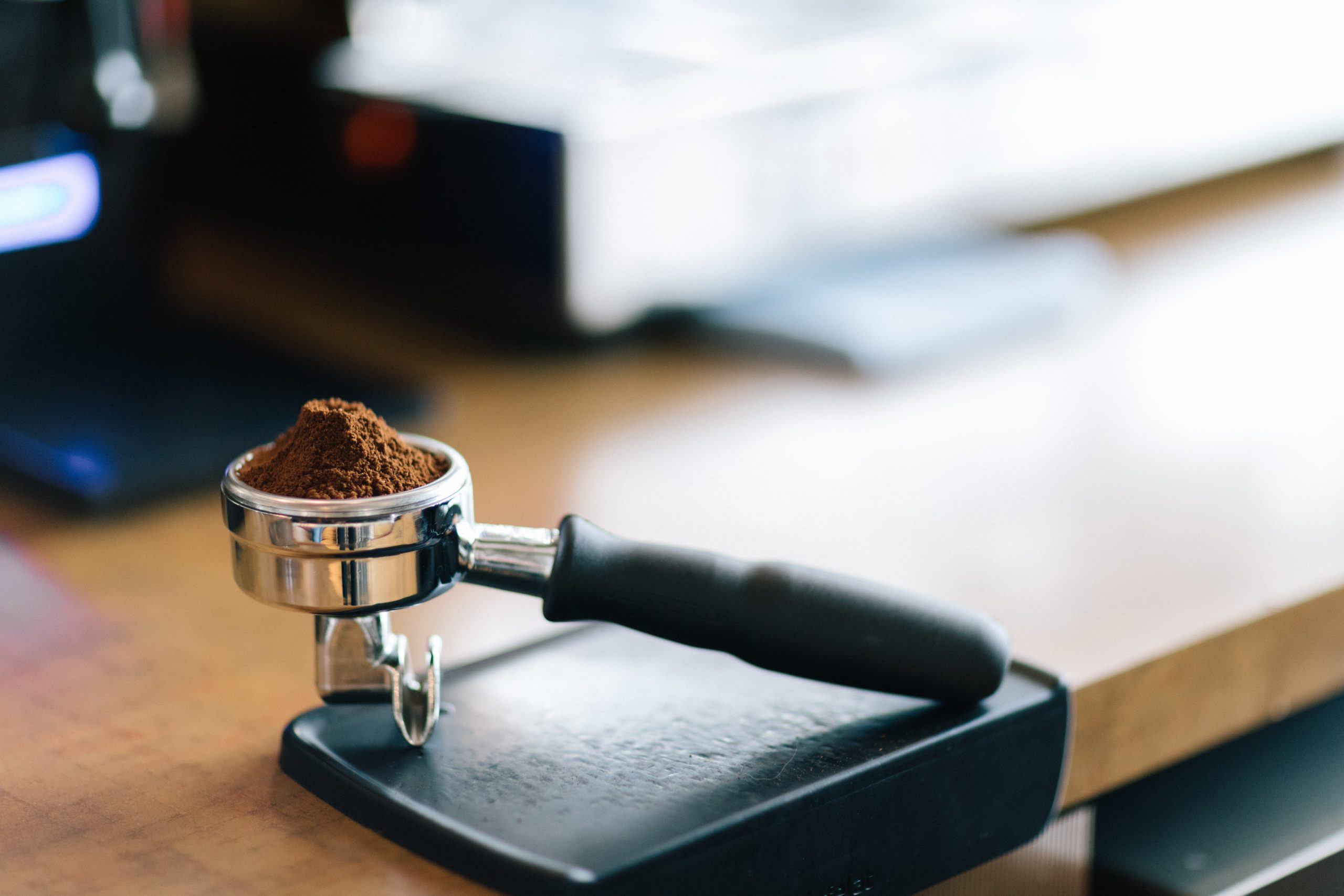 a heap of coffee grounds in a portafilter