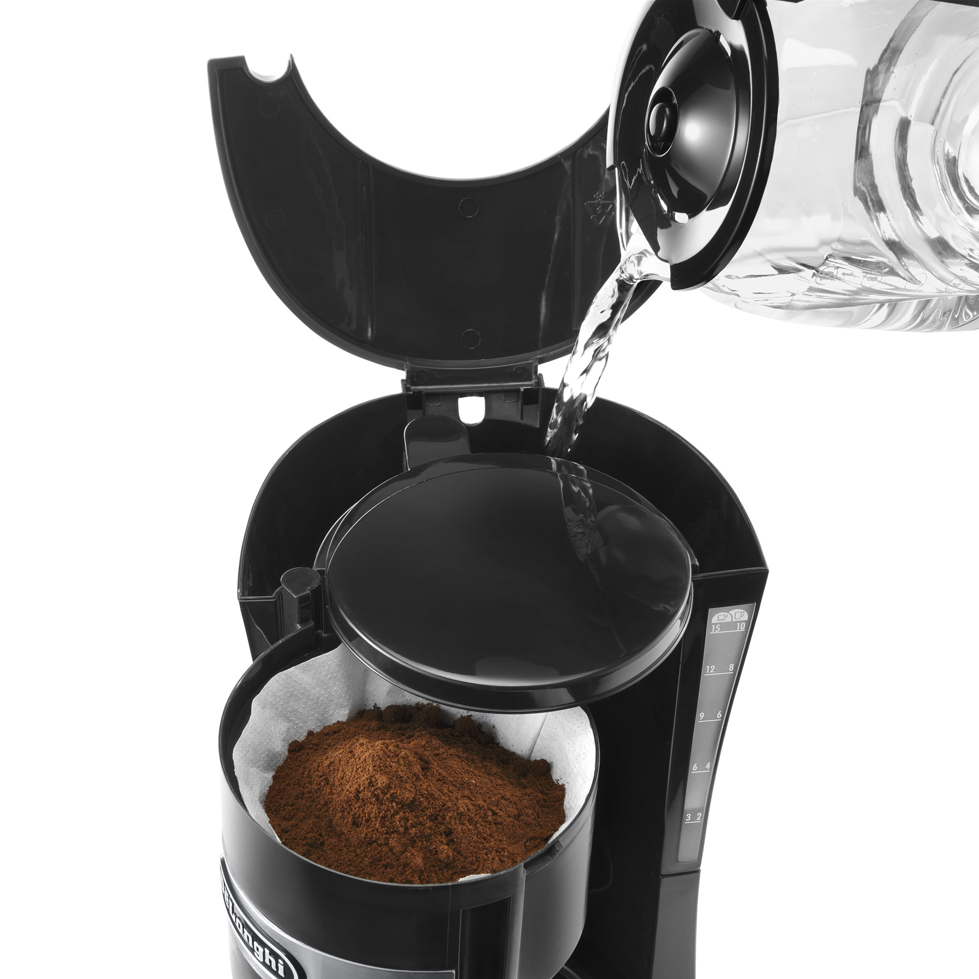 pouring water into a drip coffee machine