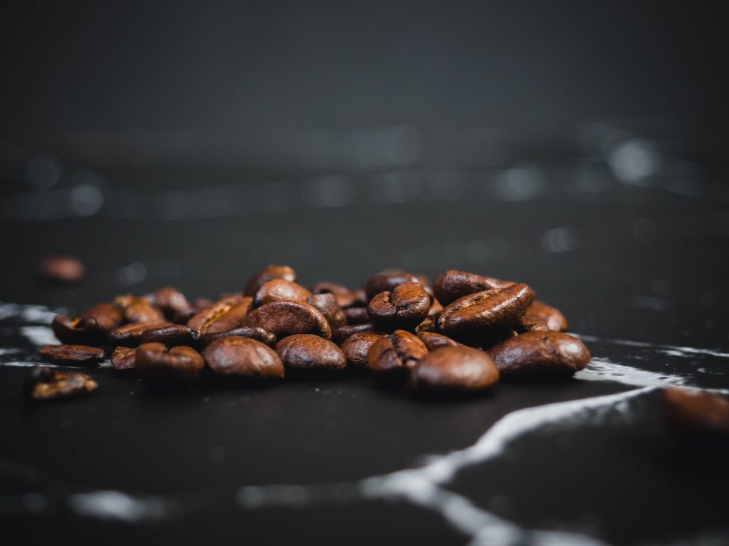coffee beans scattered on a black marble table