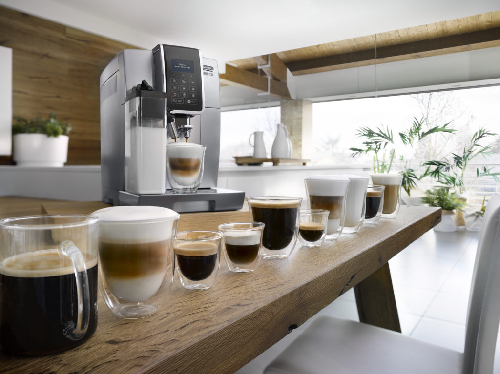 a coffee machine and several coffee beverages placed on a table
