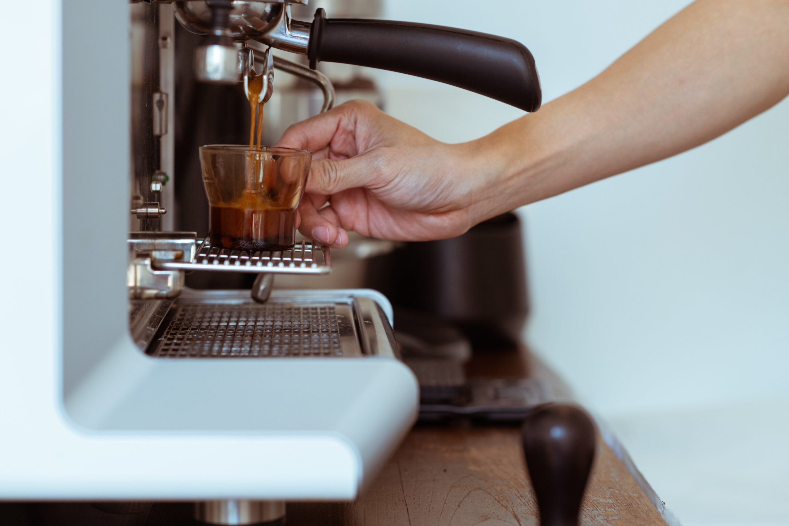 espresso being extracted from a machine