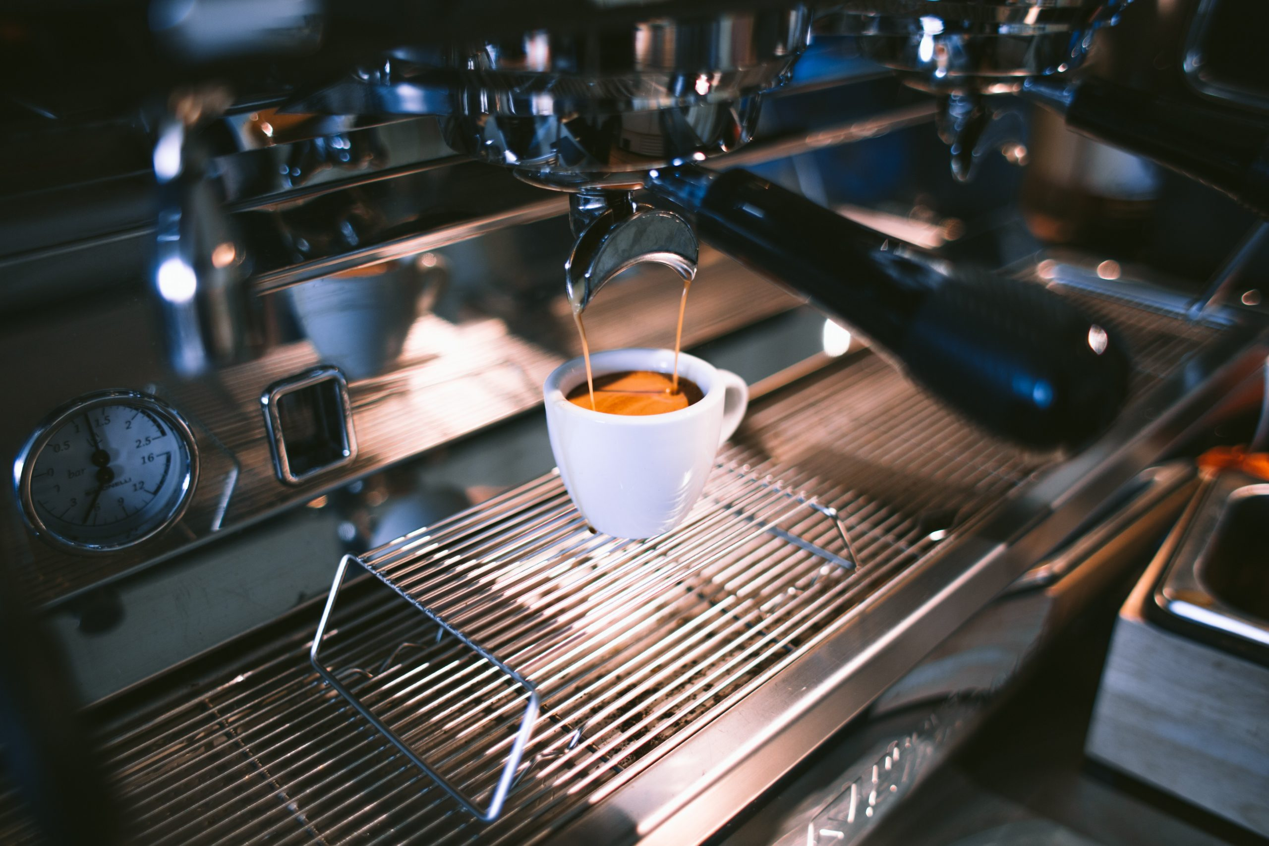 espresso being extracted from an espresso machine