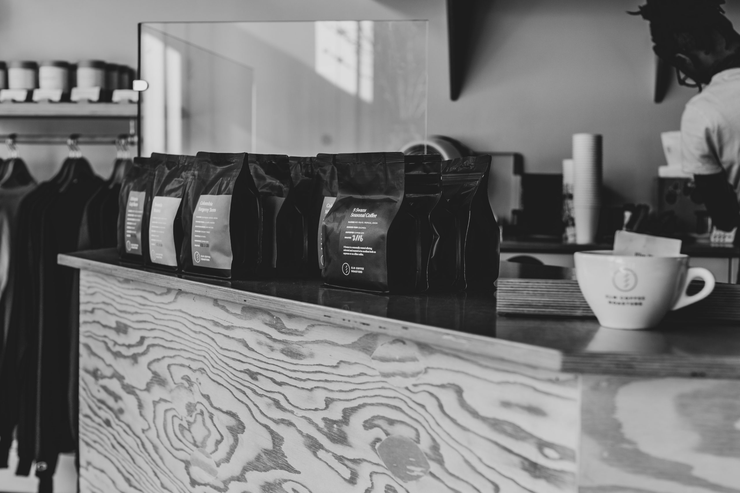 multiple bags of coffee bags on a counter