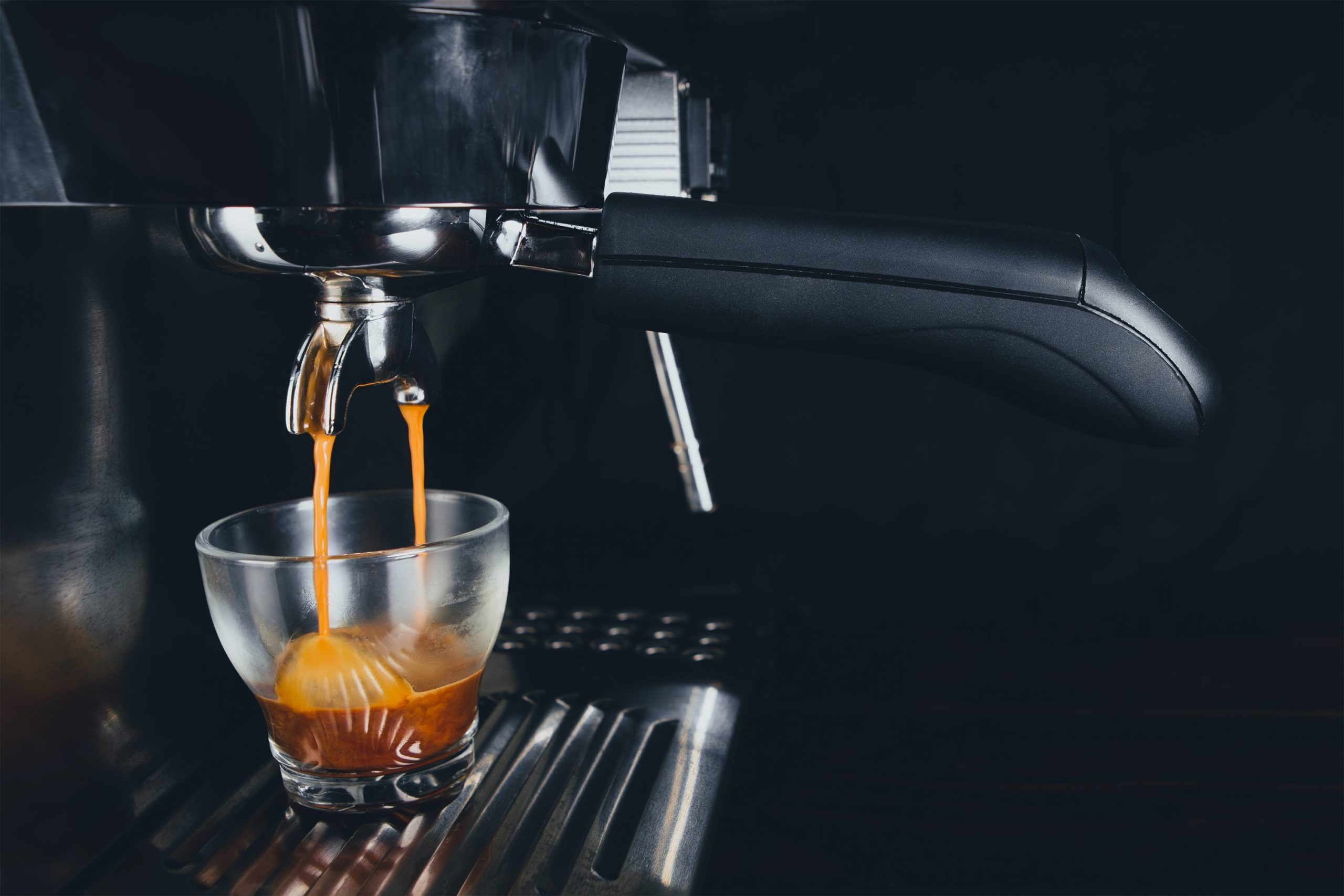 espresso being extracted into a cup