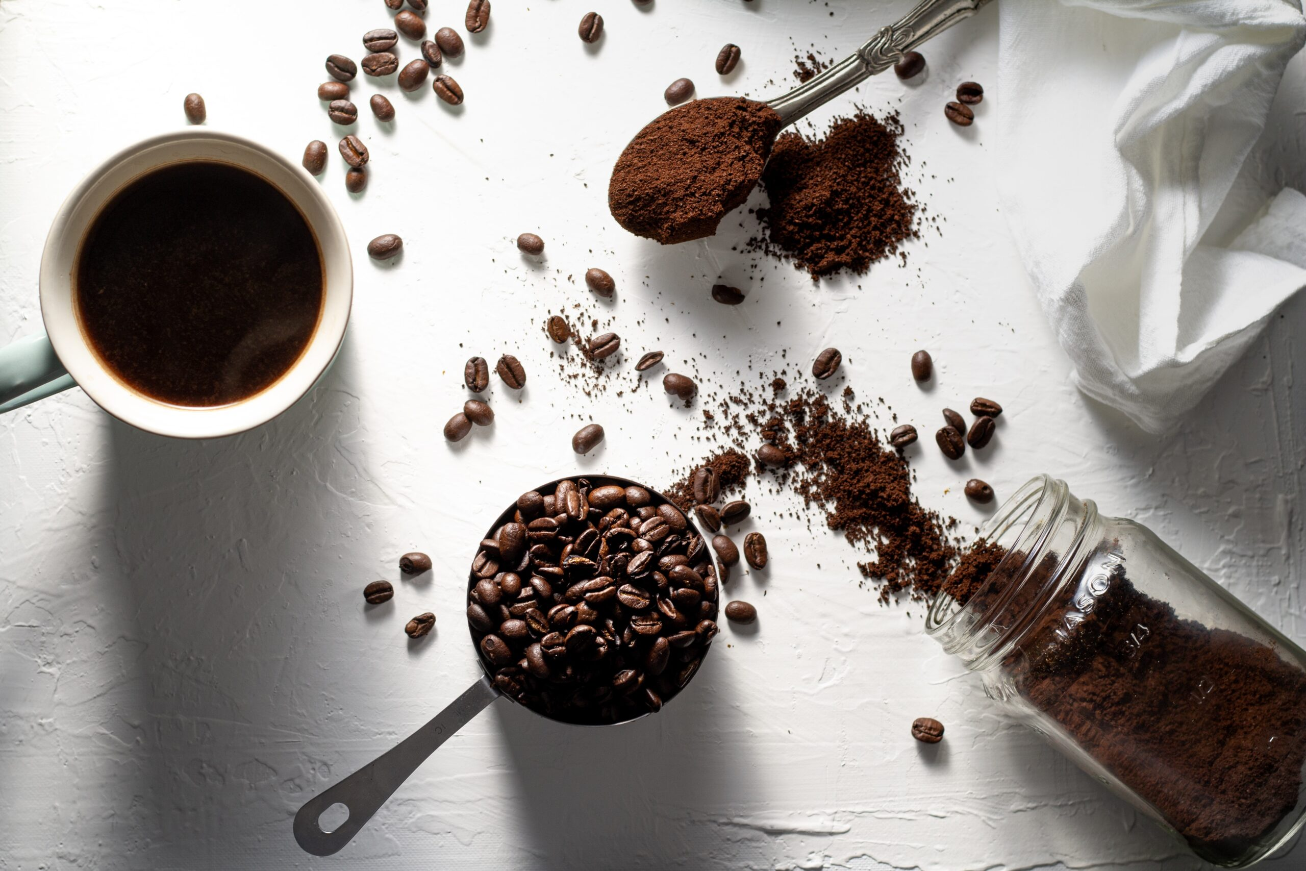 coffee beans scattered across a table