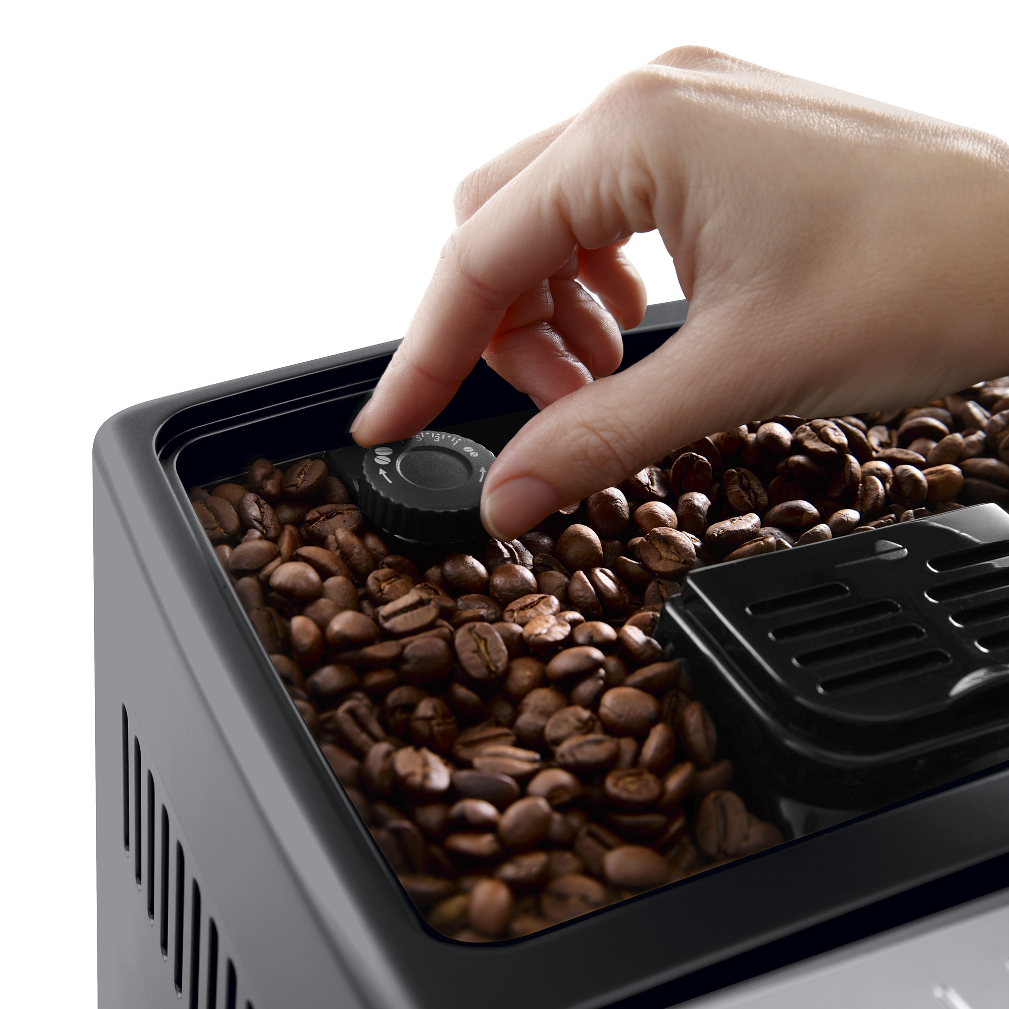 a person turning a knob on a coffee machine