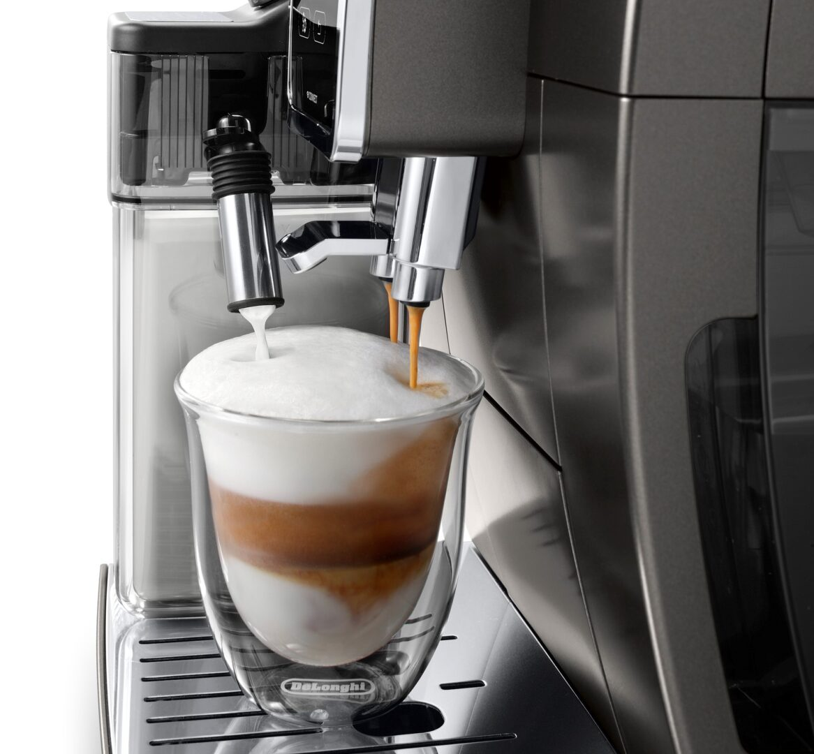 De'Longhi Dinamica Plus coffee machine extracting a cup of coffee