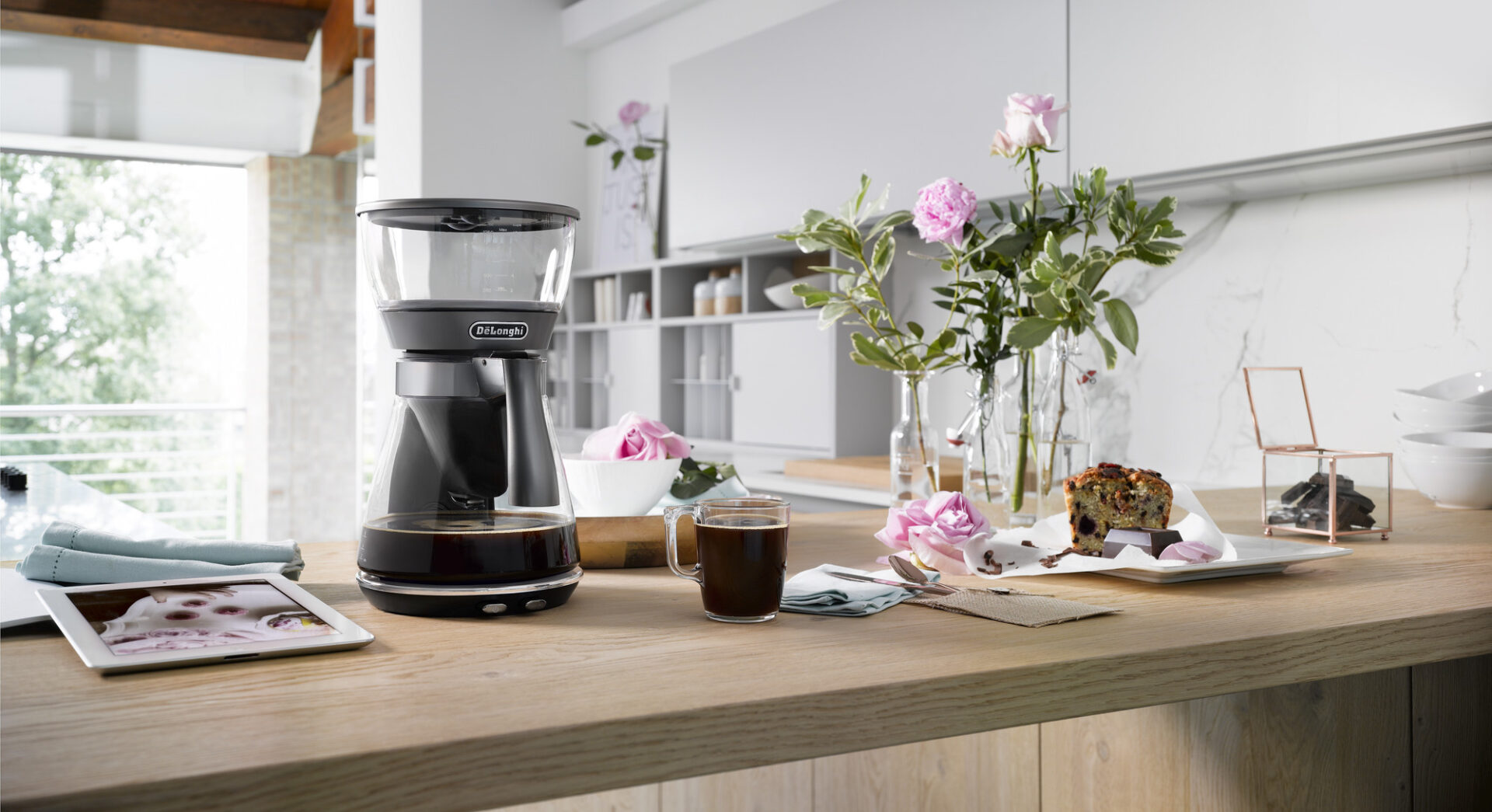 a drip coffee machine placed on a kitchen countertop