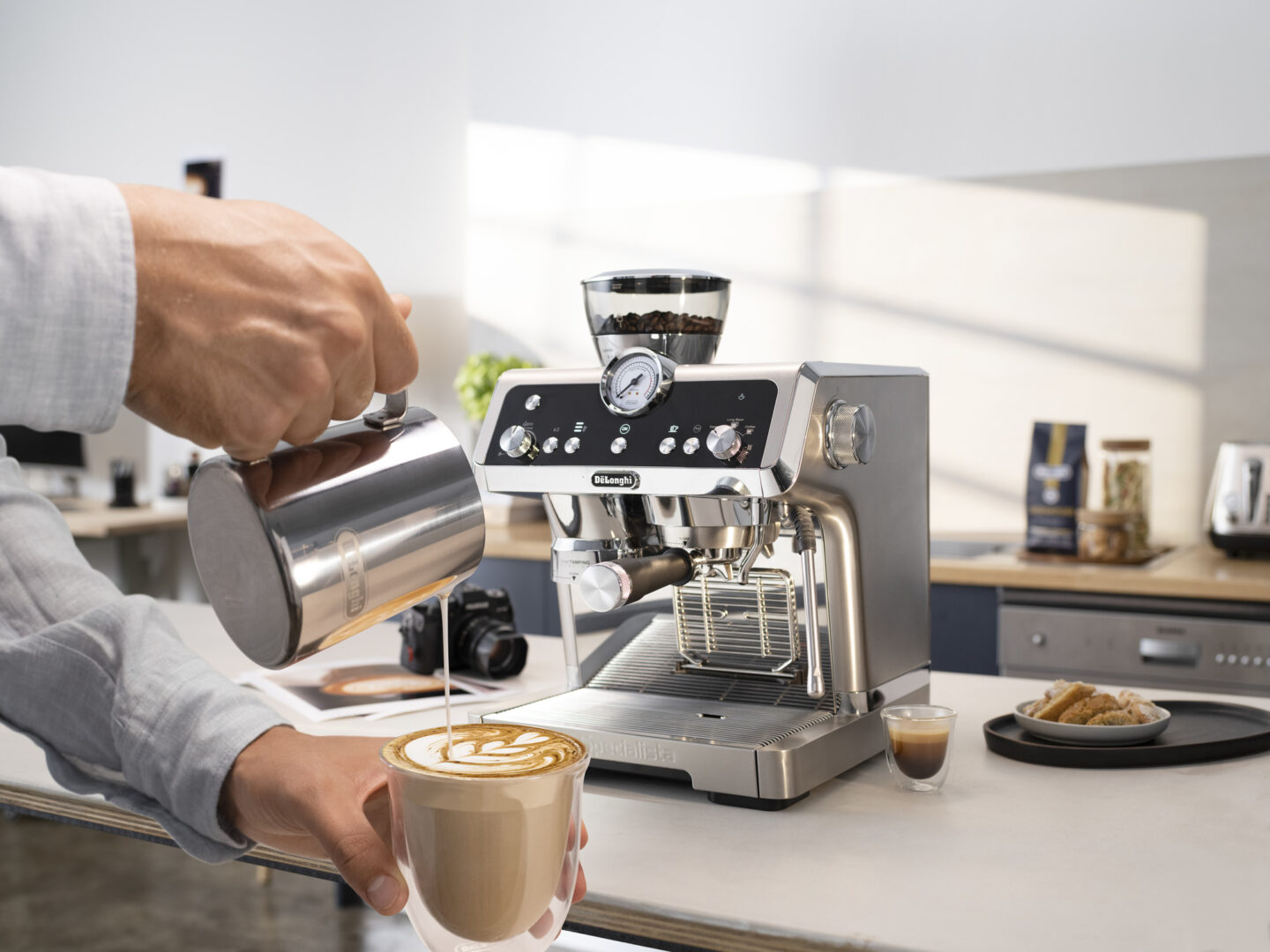 creating latte art from frothed milk made from the De'Longhi La Specialista Prestigio coffee machine