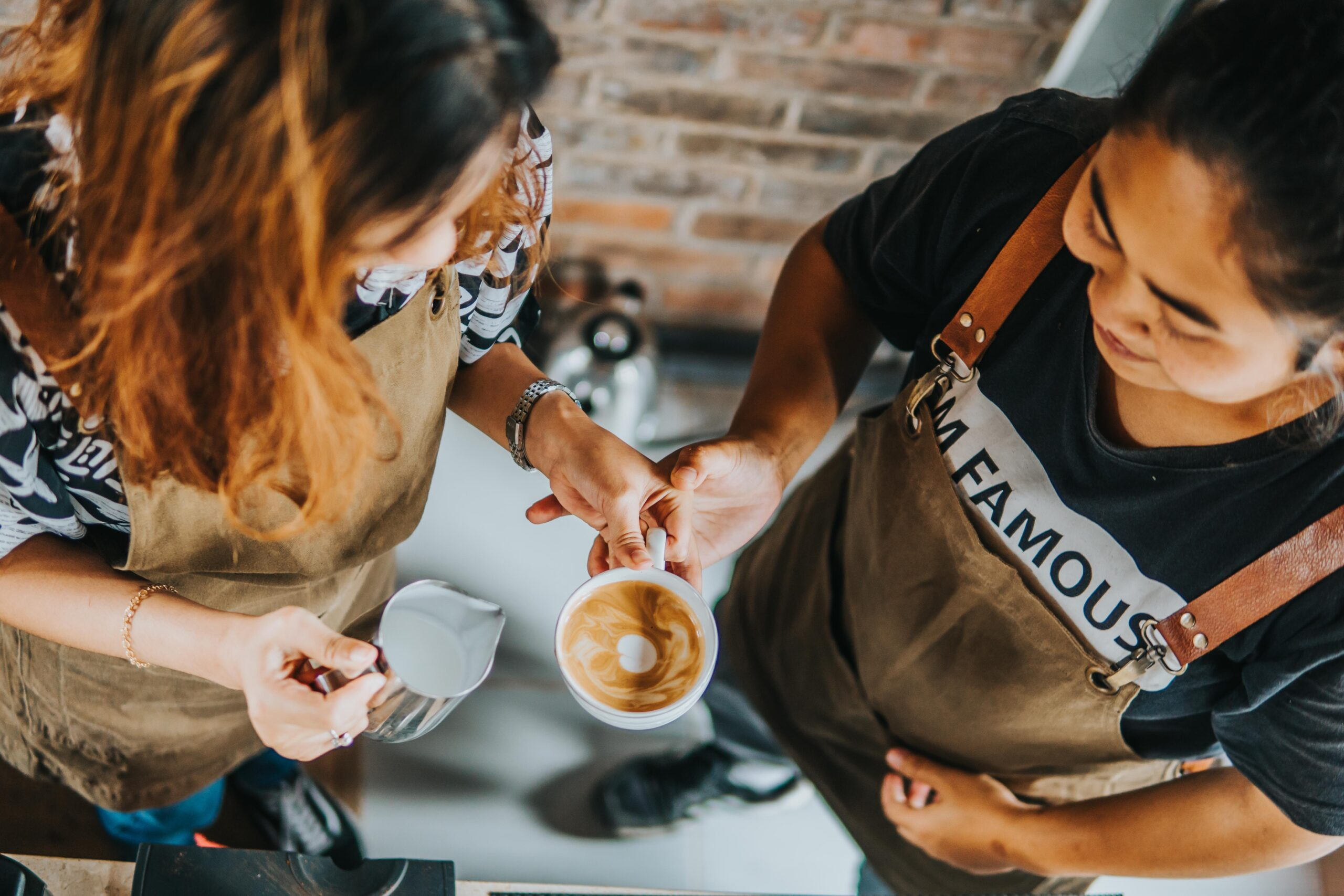 two ladies learning how to pour latte art